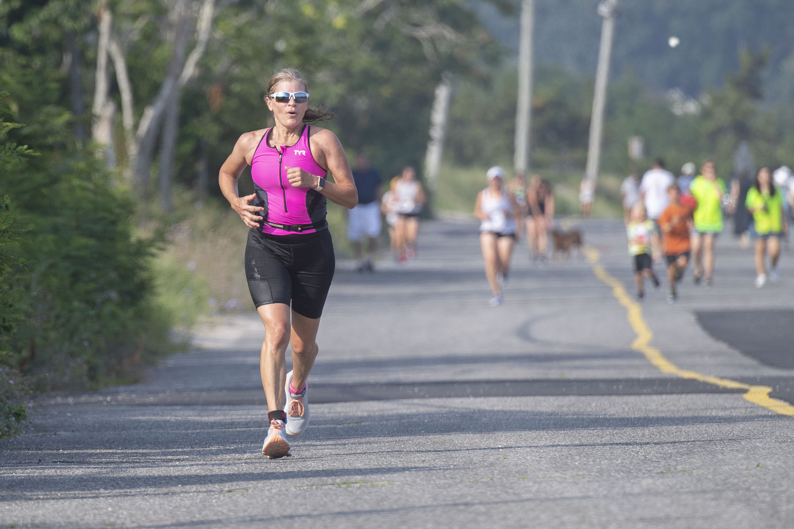 Kim Covell, assistant editor for the Express News Group, competes in the 1.5 mile run leg of the Hamptons Young at Heart Triathlon, held at Long Beach in Sag Harbor this past Saturday, July 17.