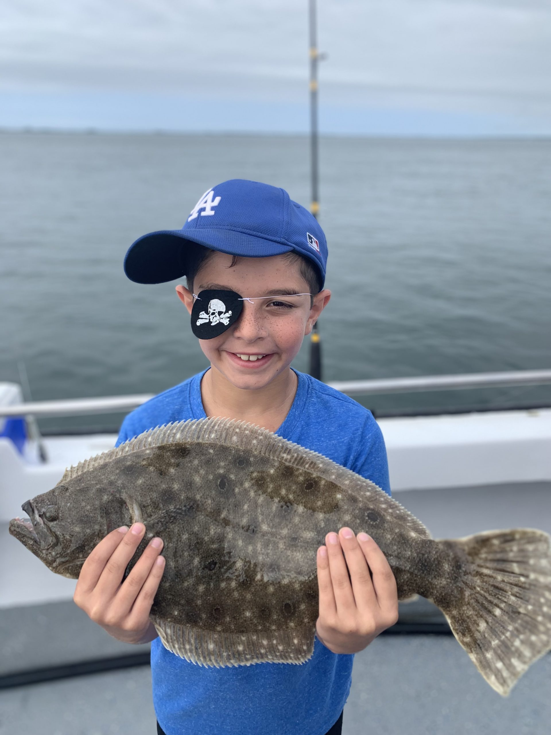 Tommy Savastano, fluke pirate extraordinaire, with the plunder from a recent trip aboard the Shinnecock Star with his cousin Deena Lippman.