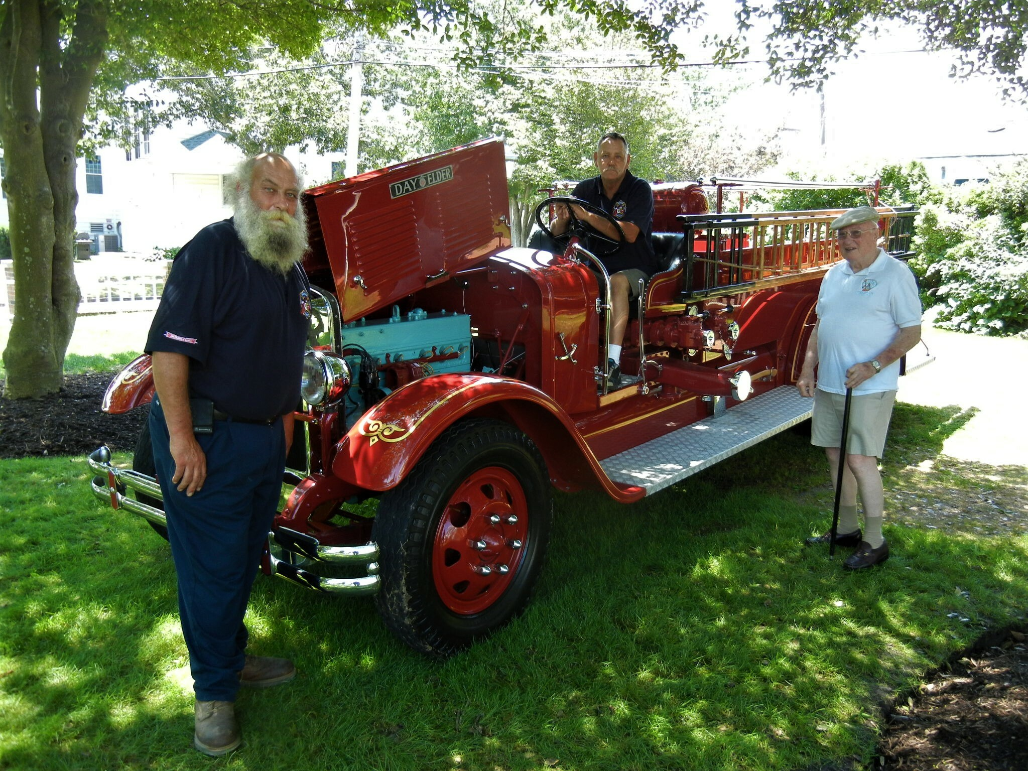 Volunteers with one of the antique fire trucks on display in 2018.