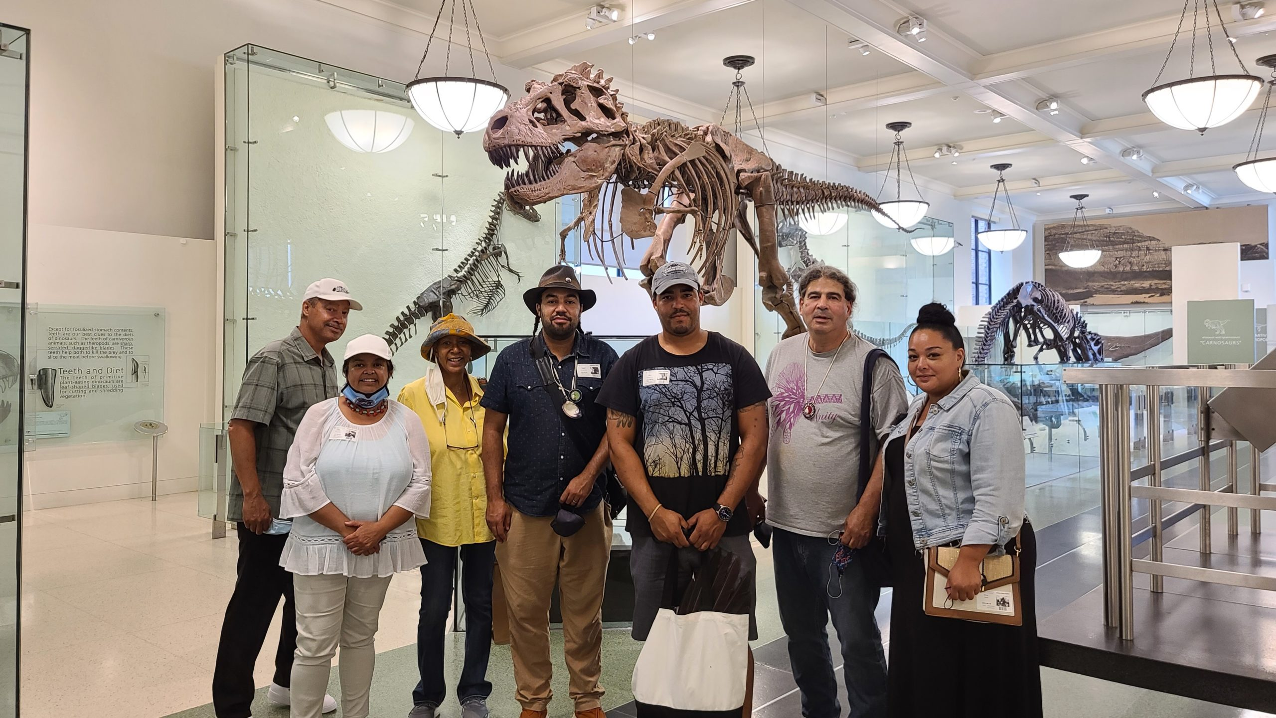 Avery Dennis, Denise Silva-Dennis, Candece Tarpley, Tecumseh Ceasar, Shane Weeks, Harry Wallace, and  Bianca Collins of the Shinnecock Nation Graves Protection Warrior Society at the American Museum of Natural History last week. COURTESY SHANE WEEKS