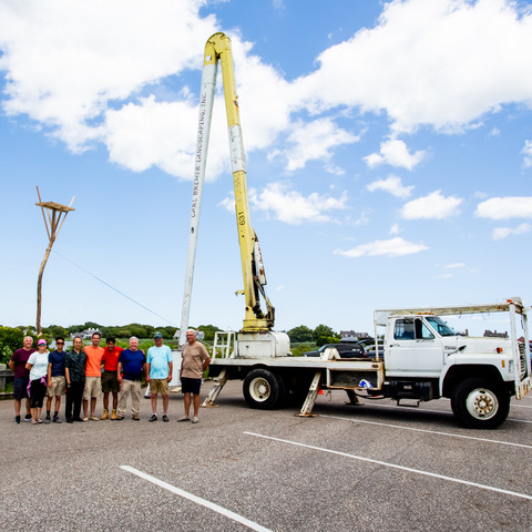 As a part of his Eagle Scout project, Sam Tran worked with fellow Boy Scouts, Southampton Town Trustee Bill Pell and arborist Peter Grealish to install an osprey nest in Lake Agawam Conservancy's south shore bioswale on Sunday.