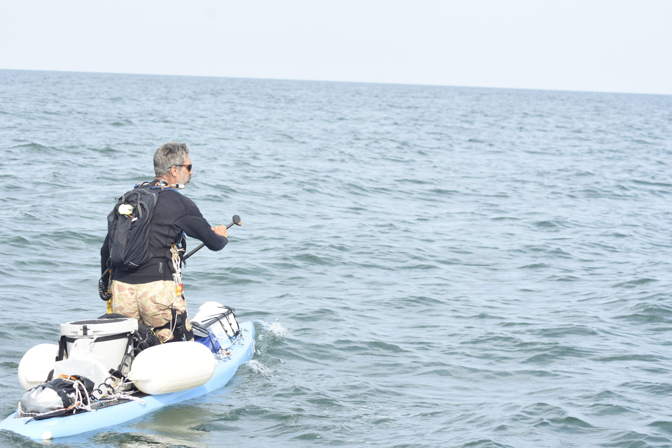 Adam Nagler paddling in the ocean just off the shores of Southampton.