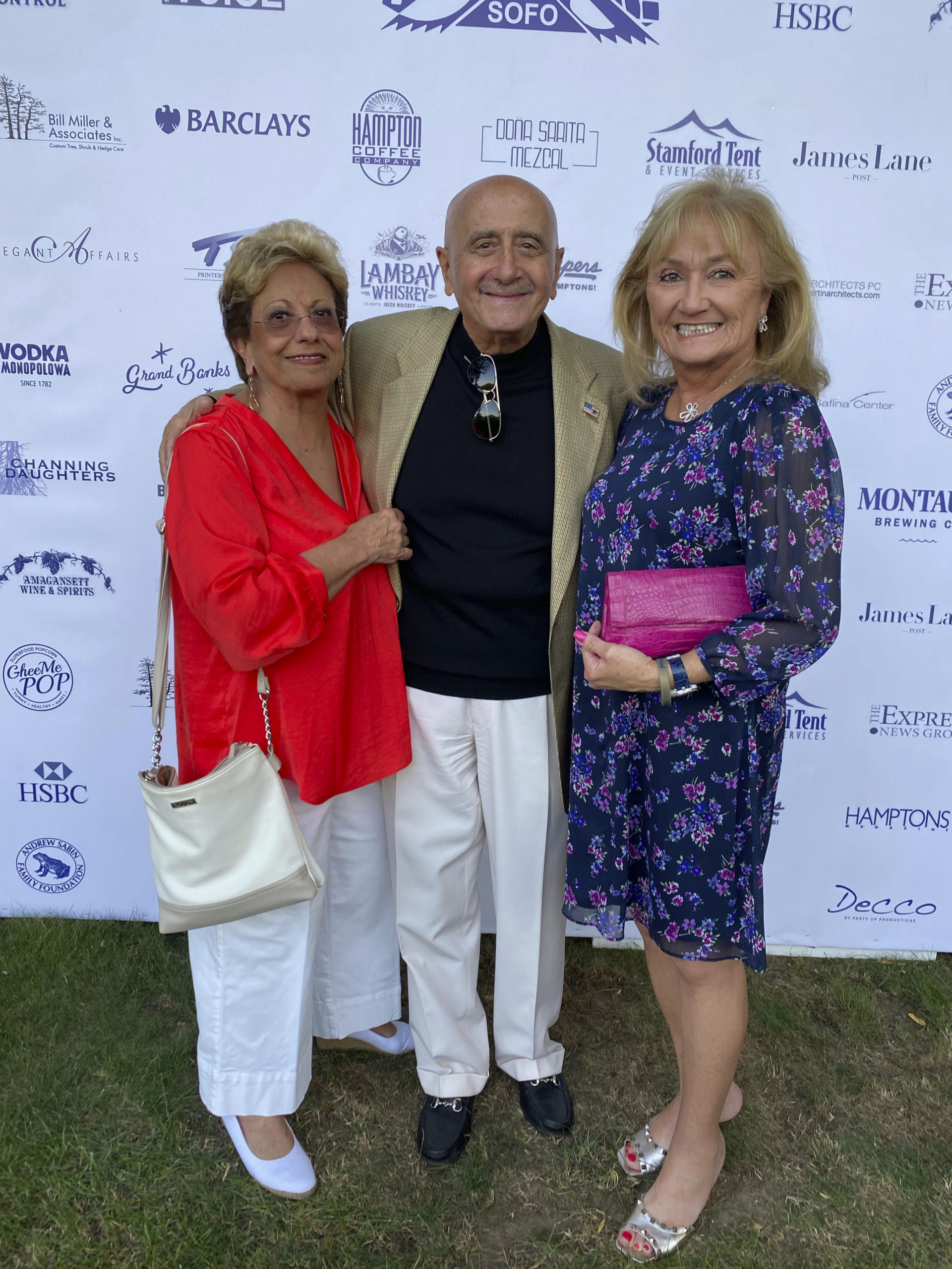 Carol Burke with Dick and Lori Grasso at the South Fork Natural History Museum summer Gala.   GREG DELIA