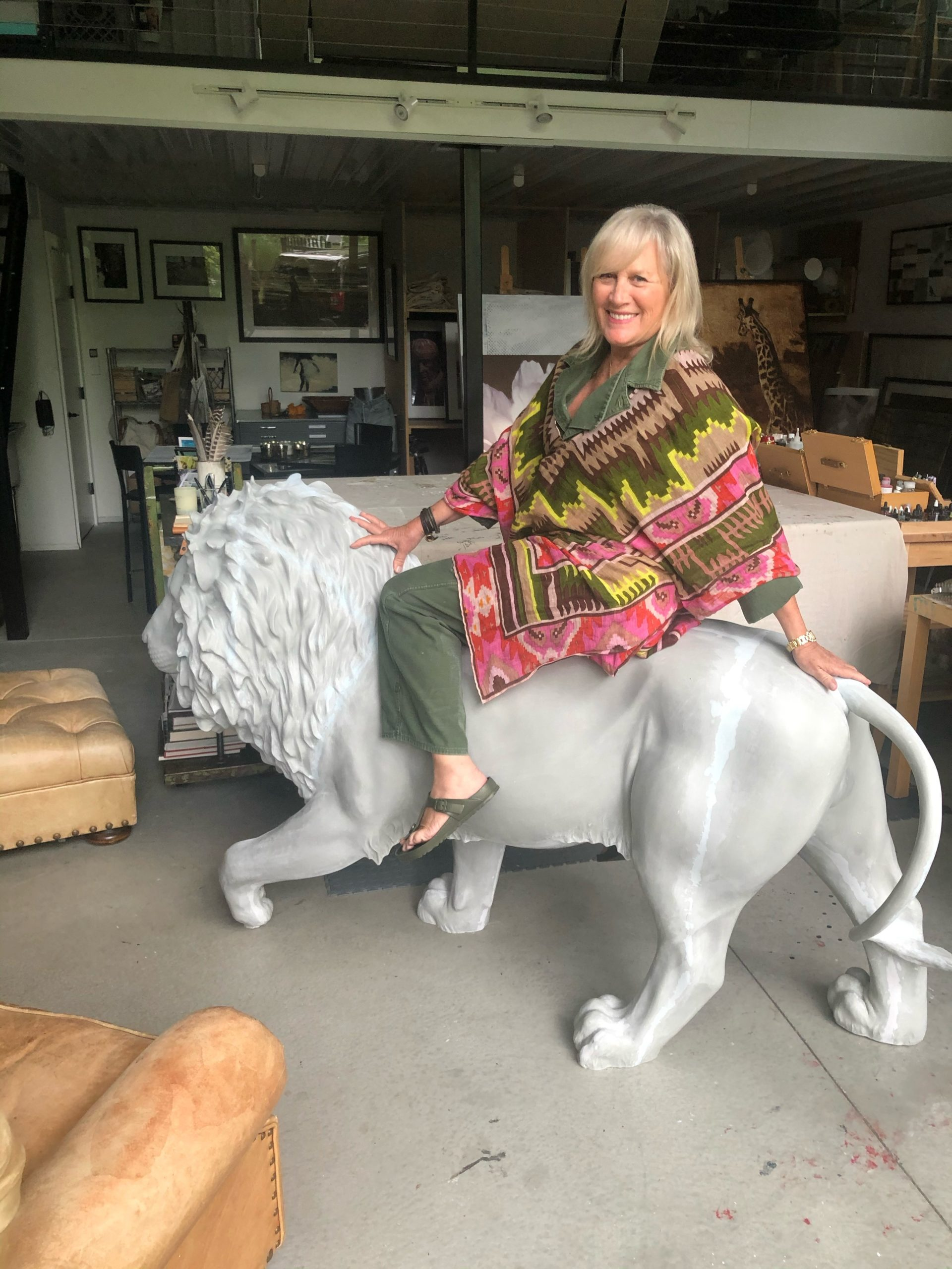 Beth O'Donnell atop her lion sculpture.