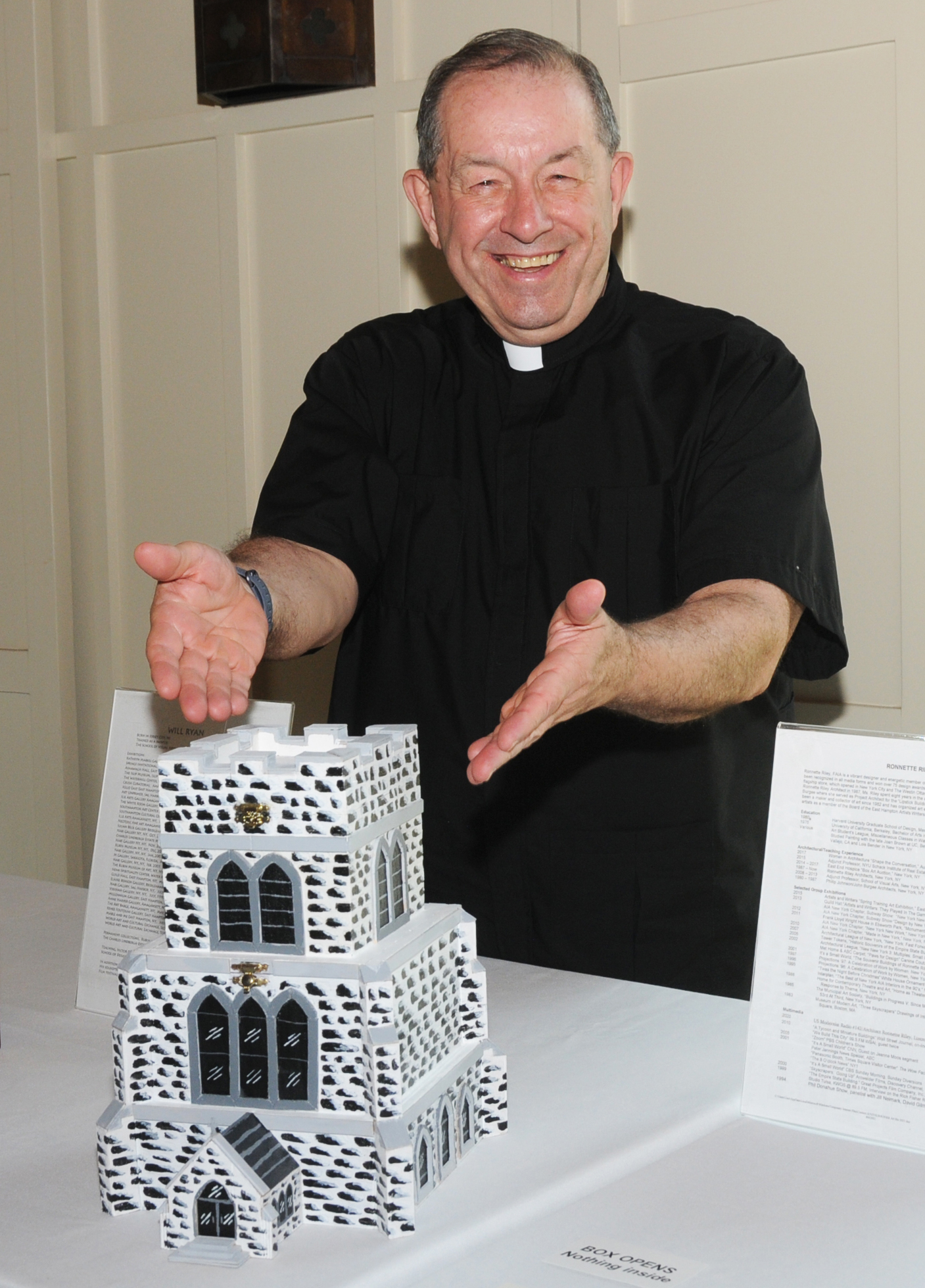 The Very Rev. Denis C. Brunelle at the East End Hospice Art Box Auction preview on Thursday evening at at Hoie Hall in St. Luke's Episcopal Church in East Hampton. More than 80 decorated boxes were auctioned on Saturday to benefit East End Hospice.    RICHARD LEWIN