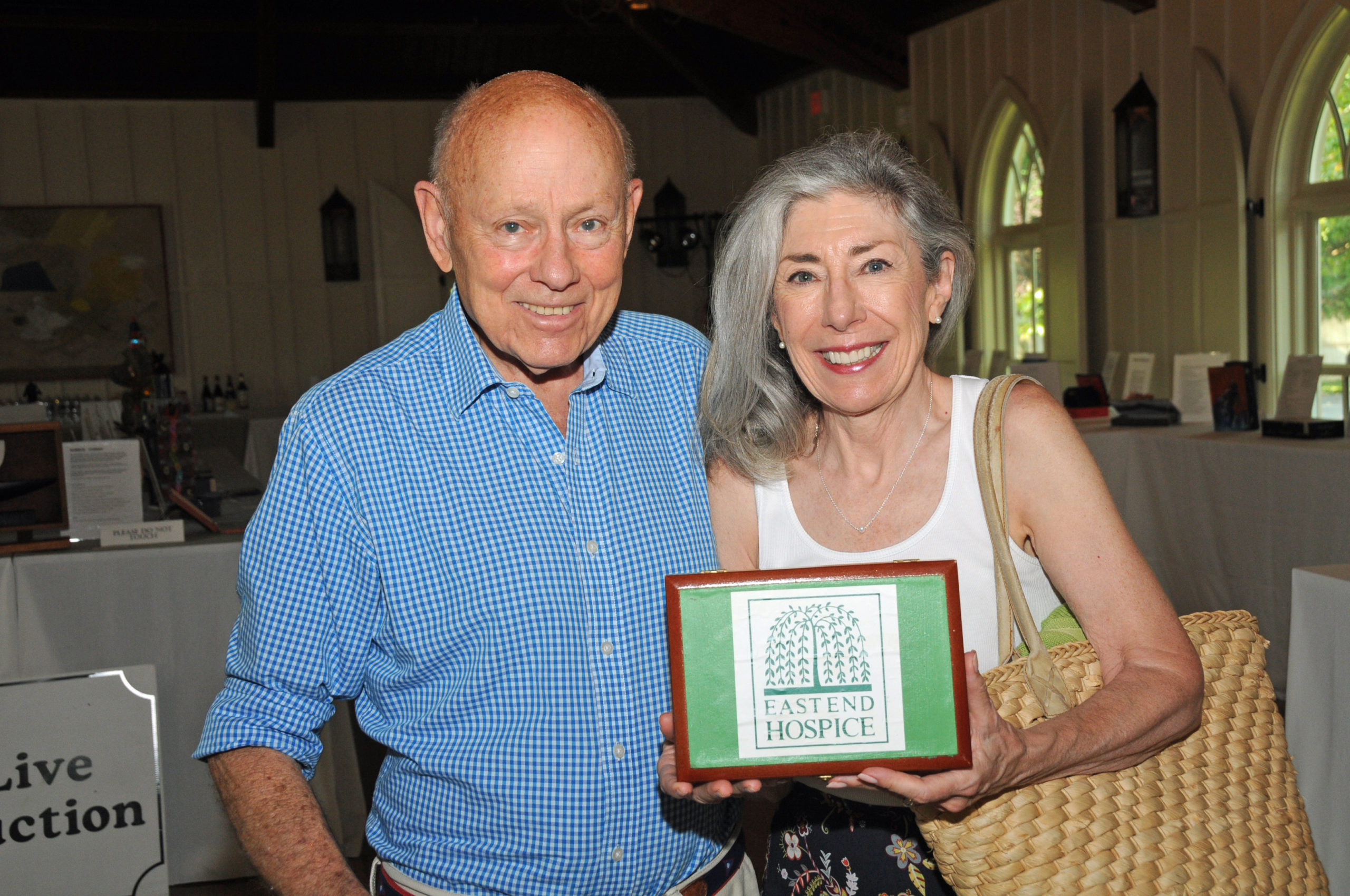 Ted David and Louise Merriman at the East End Hospice Art Box Auction preview on Thursday evening at at Hoie Hall in St. Luke's Episcopal Church in East Hampton. More than 80 decorated boxes were auctioned on Saturday to benefit East End Hospice.    RICHARD LEWIN