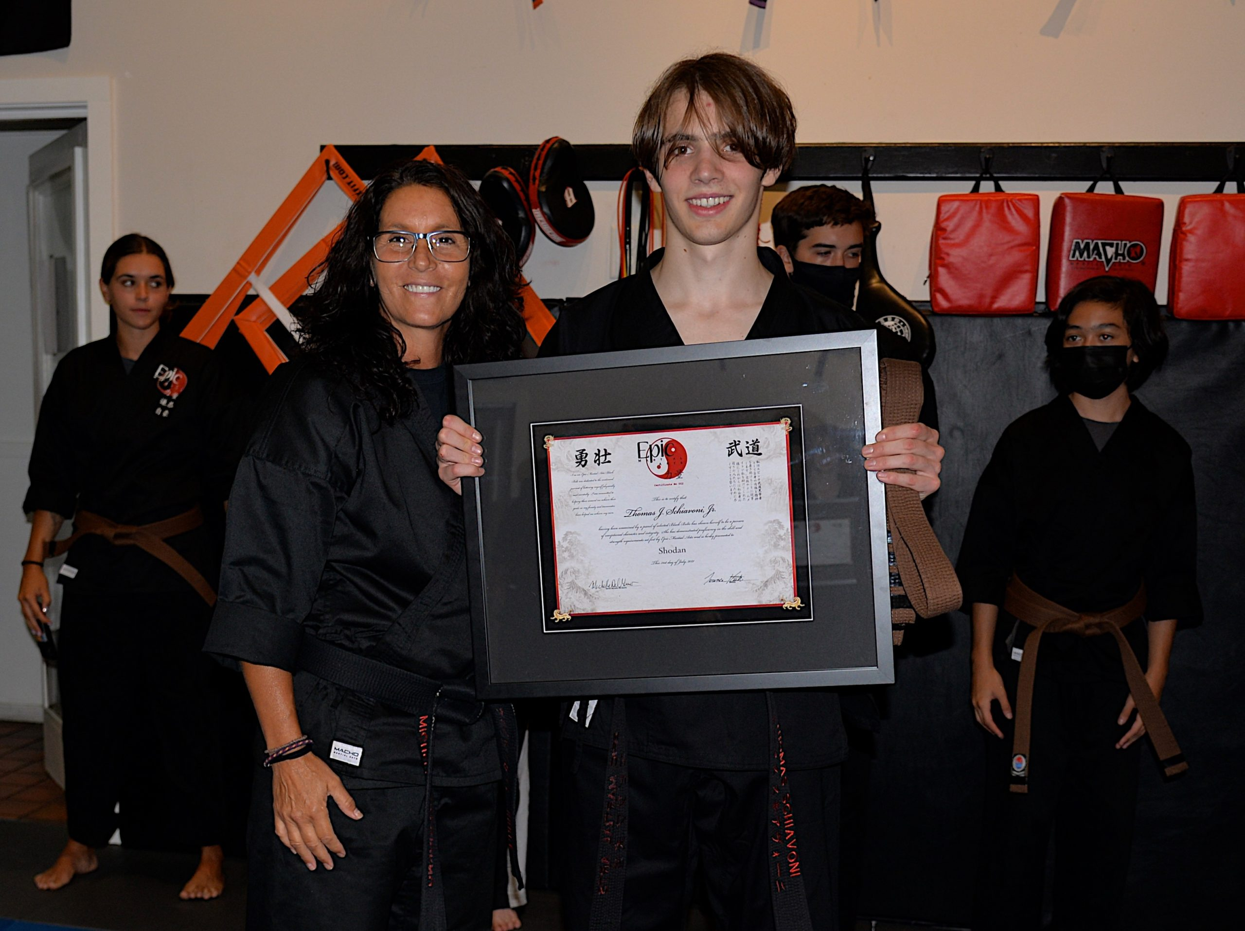 EPIC Martial Arts sensei Michelle Del Giorno with Thomas Schiavoni after he passed his black belt test this past Saturday.