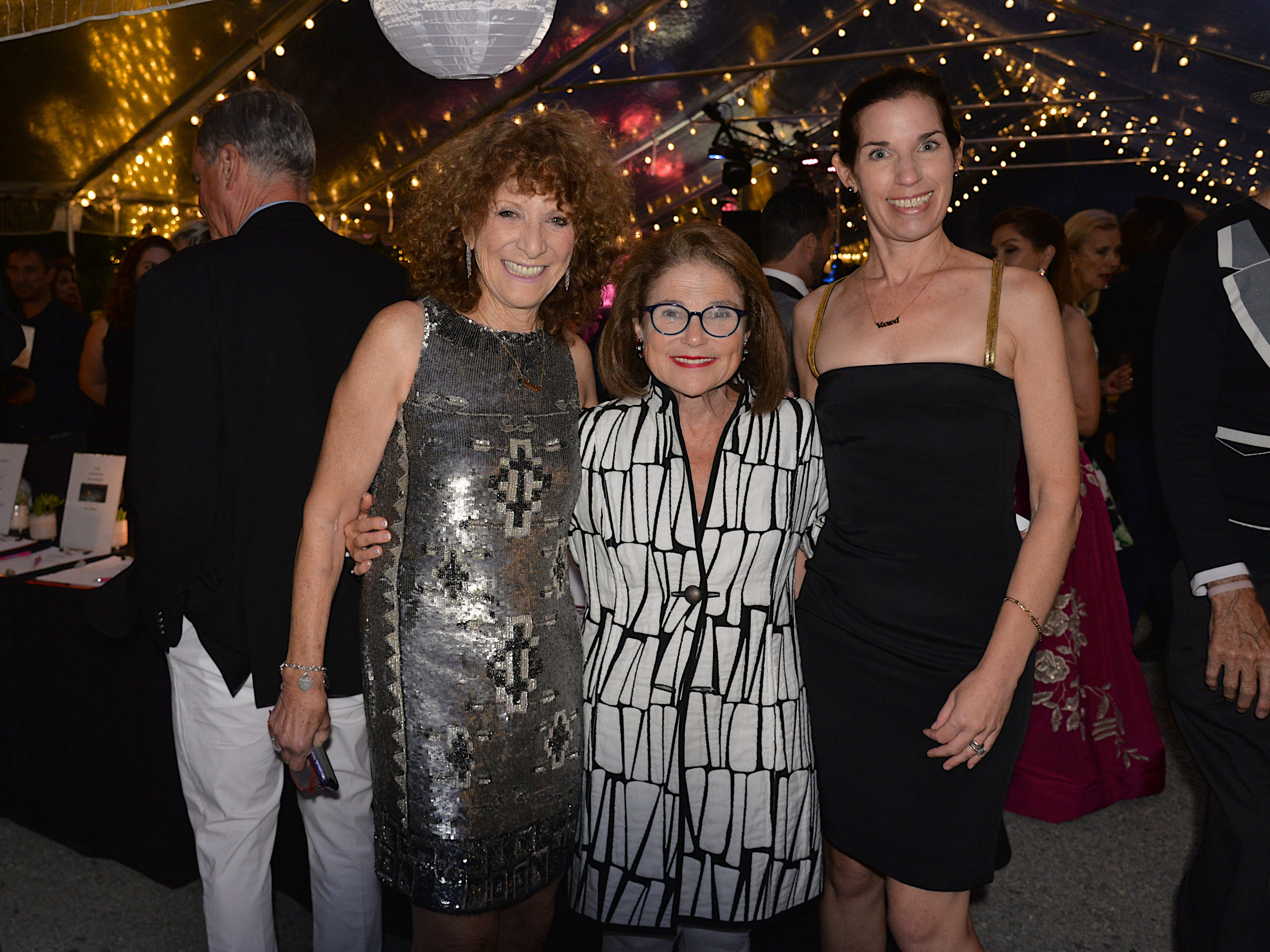 Julie Ratner, honoree Tovah Feldshuh and Anne Gomberg at the Ellen Hermanson Foundation's Back in Black summer benefit on Saturday at Hampton Racquet.   KYRIL BROMLEY