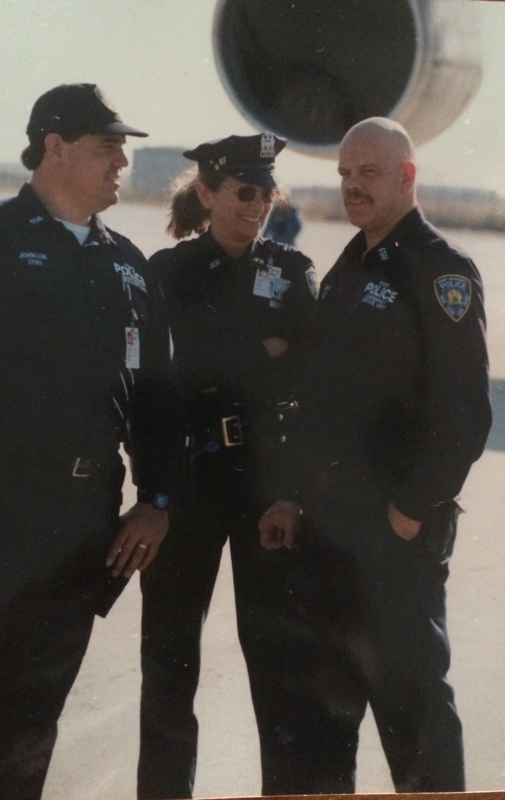Port Authority Police Officers Pete Johnson, Doris Caridi and George Howard prior to September 11, 2001. Mr. Howard was killed by raining debris during the aftermath of the terrorist attack, after rushing to the scene on his day off to help.
