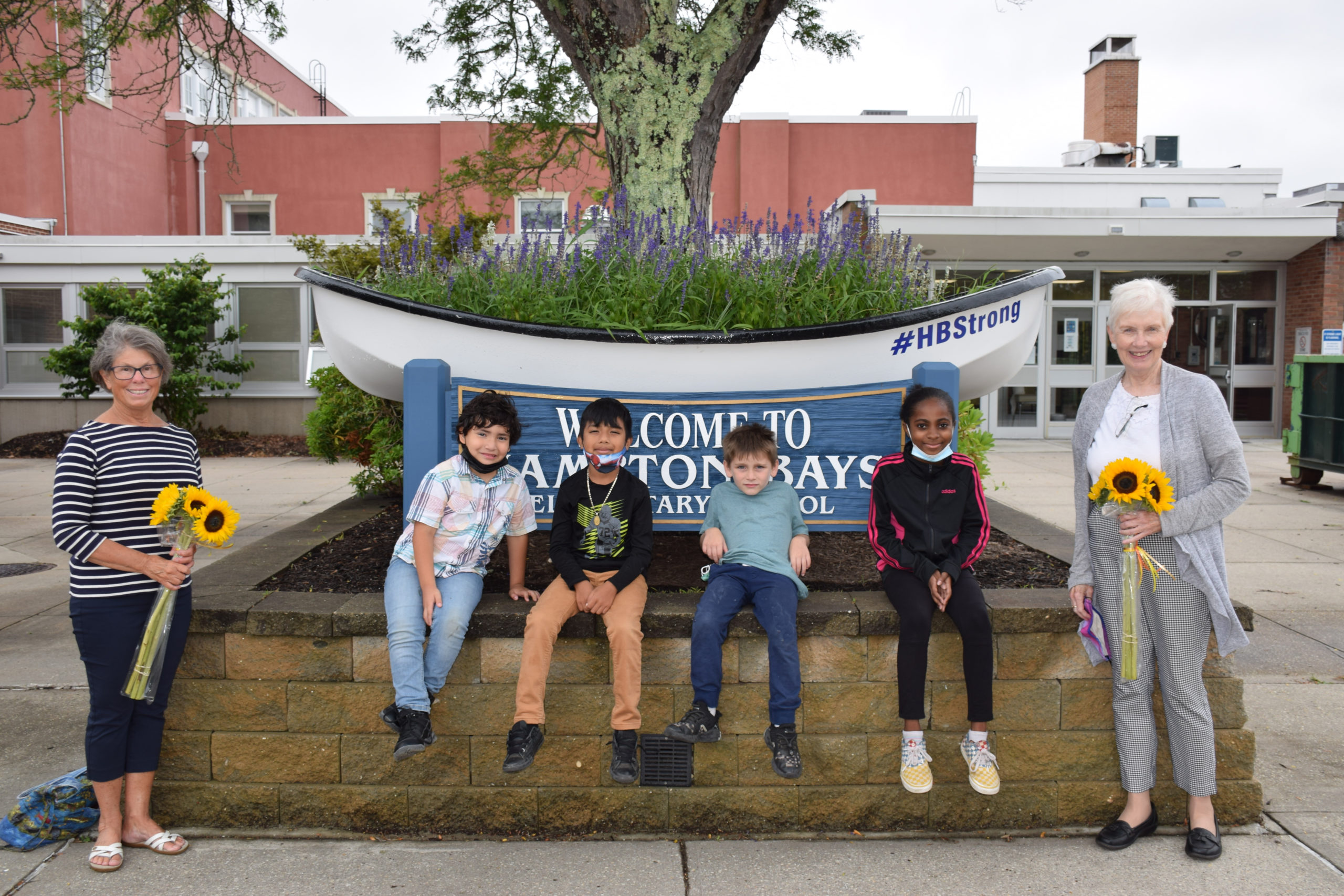 """Hampton Bays students spent their summer learning and playing through the district's academic support program and SCOPE's """"Summer Fun"""" program. Pictured with the students is Terry Wildrick of Neighbors in Support of immigrants (left) and Sister Mary Beth Moore of Centro Corazón de María (right)."""