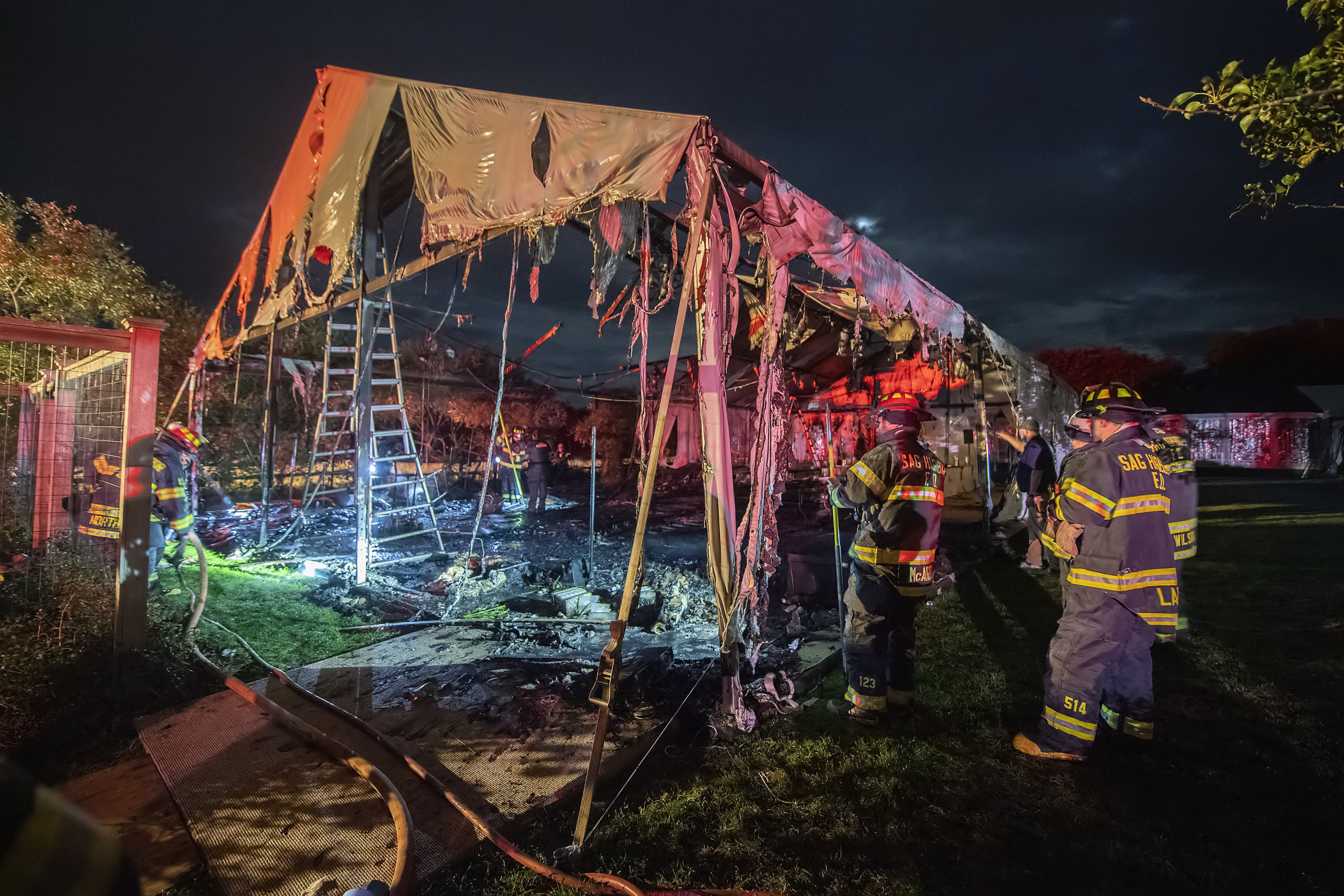 Fire swept through a large party tent Friday behind a home on Lockwood Avenue in Bridgehampton. The Bridgehampton Fire Department, with help from Sag Harbor and East Hampton firefighters, extinguished the blaze, and the party, scheduled for Saturday, went on in a second tent that had already been erected for the event. MICHAEL HELLER