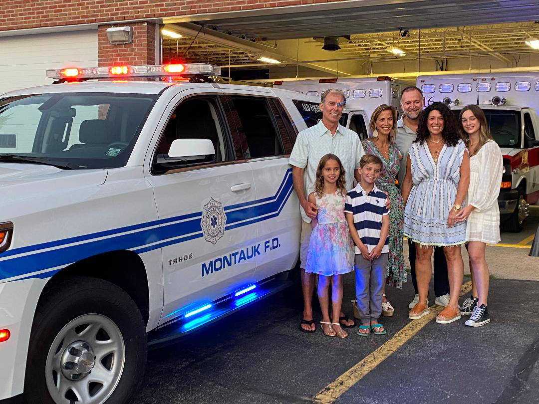 With an incredible display of generosity and community spirit, the Hildreth and Kansler Families of Montauk recently donated a critically valuable vehicle to the Montauk Fire Department. Here they are standing beside the new fully equipped Chevy Tahoe that they donated. The vehicle, designated