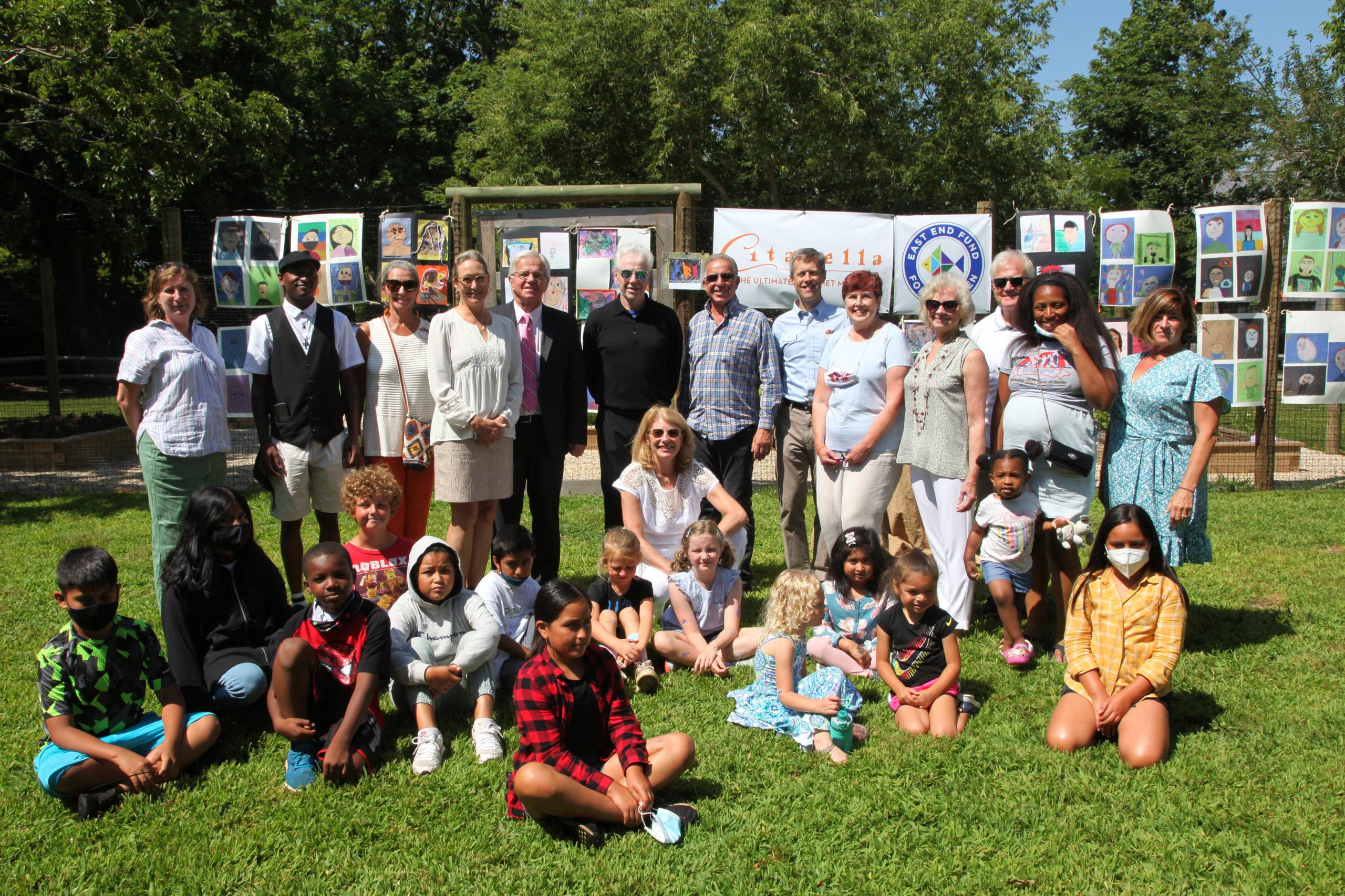 Children and community leaders gather outside Citarella in Bridgehampton to celebrate the launch of the fundraiser.