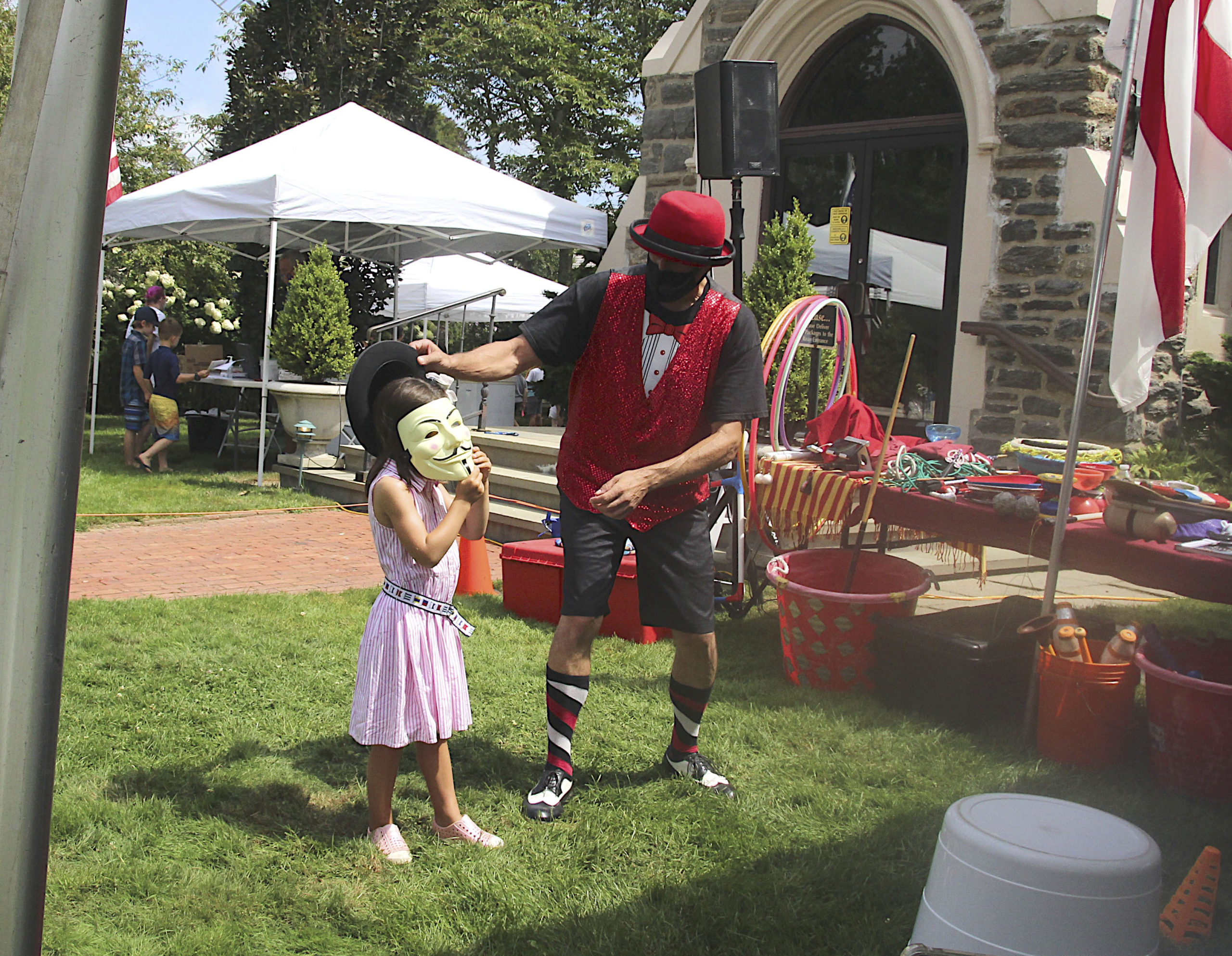 Magic Keith performs at the St. Luke's Episcopal Church Fair on Saturday.  KYRIL BROMLEY