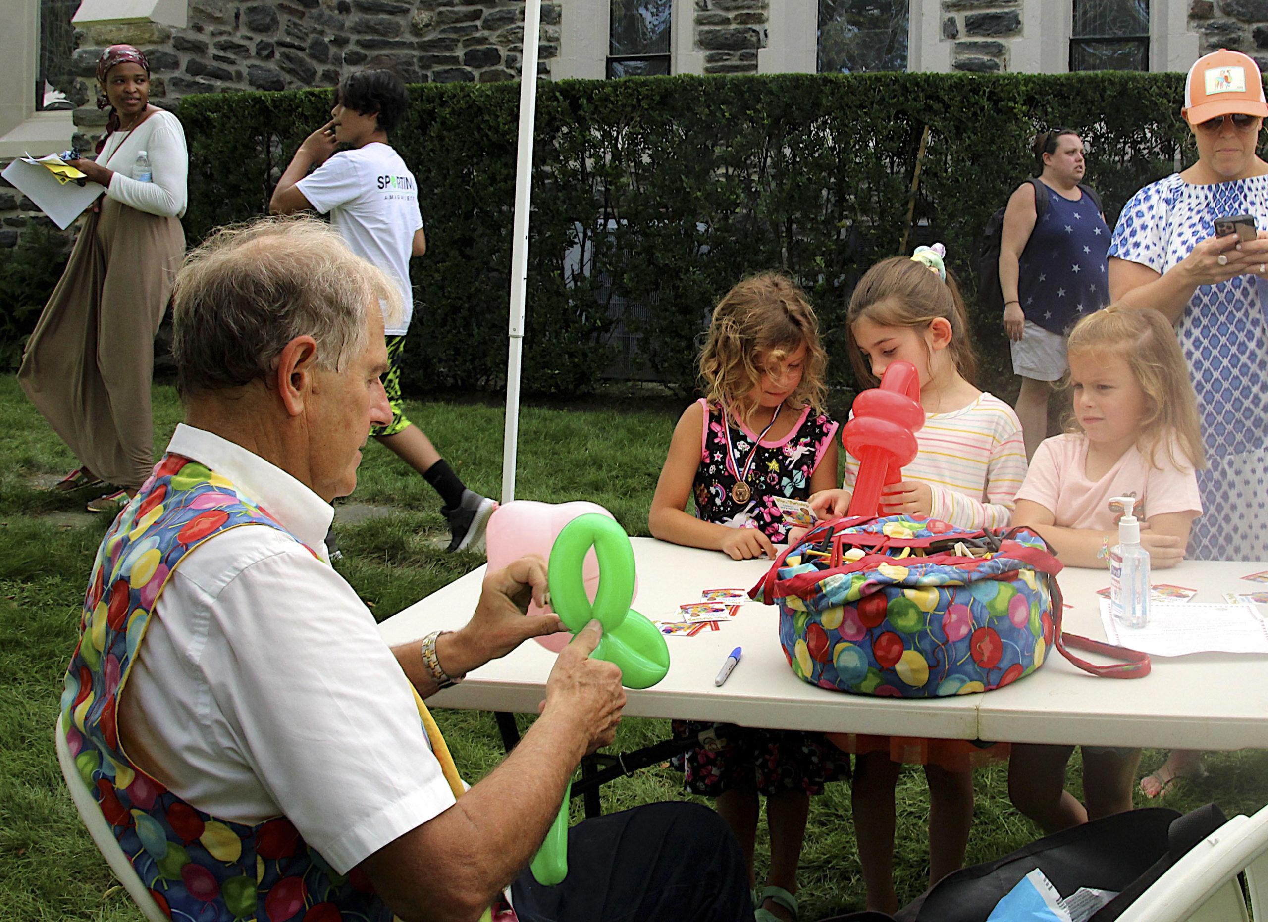 Mr. Twisty creates balloon animals at the St. Luke's Episcopal Church Fair on Saturday.  KYRIL BROMLEY