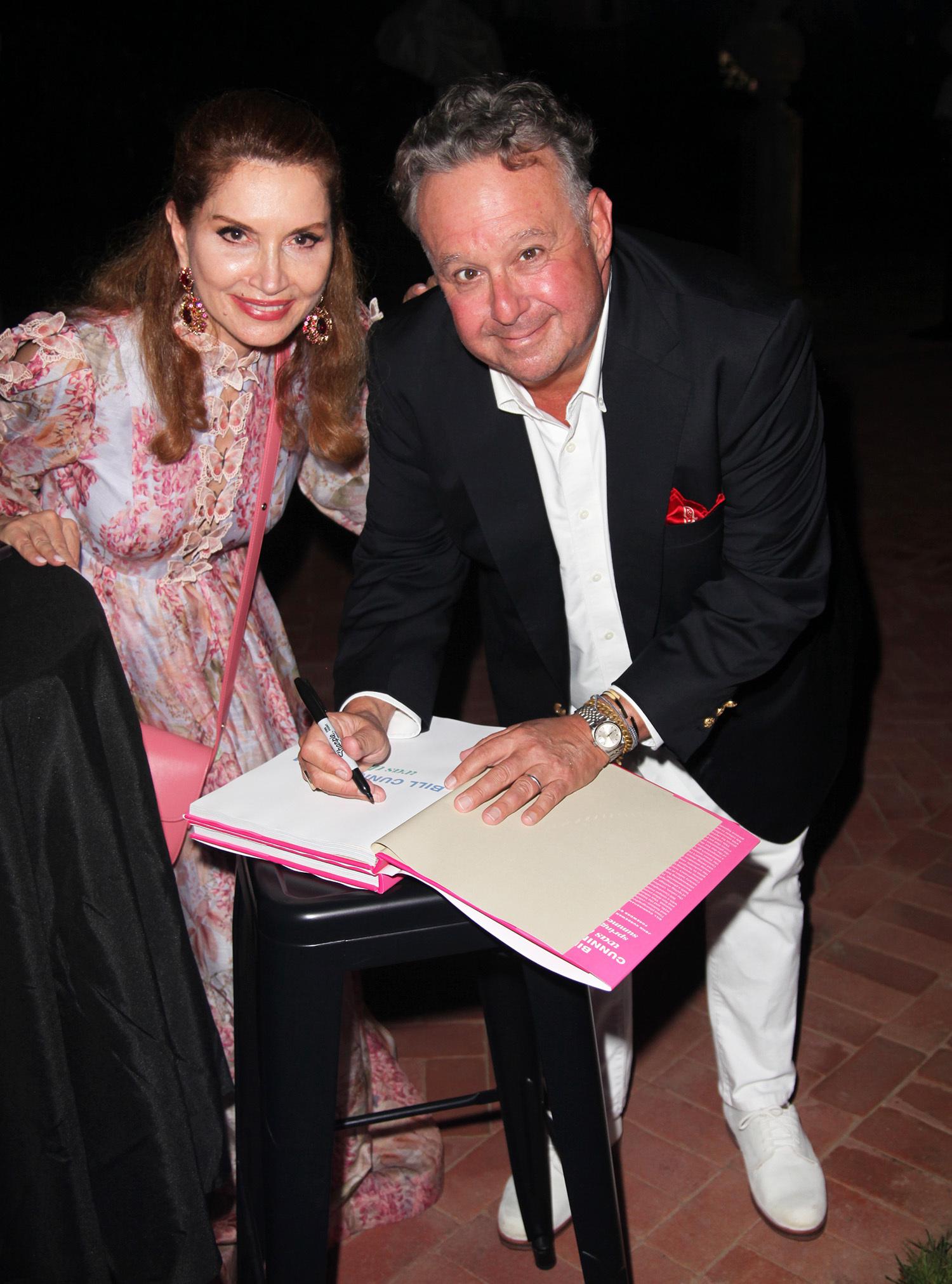 Author Steven Stolman signs a copy of