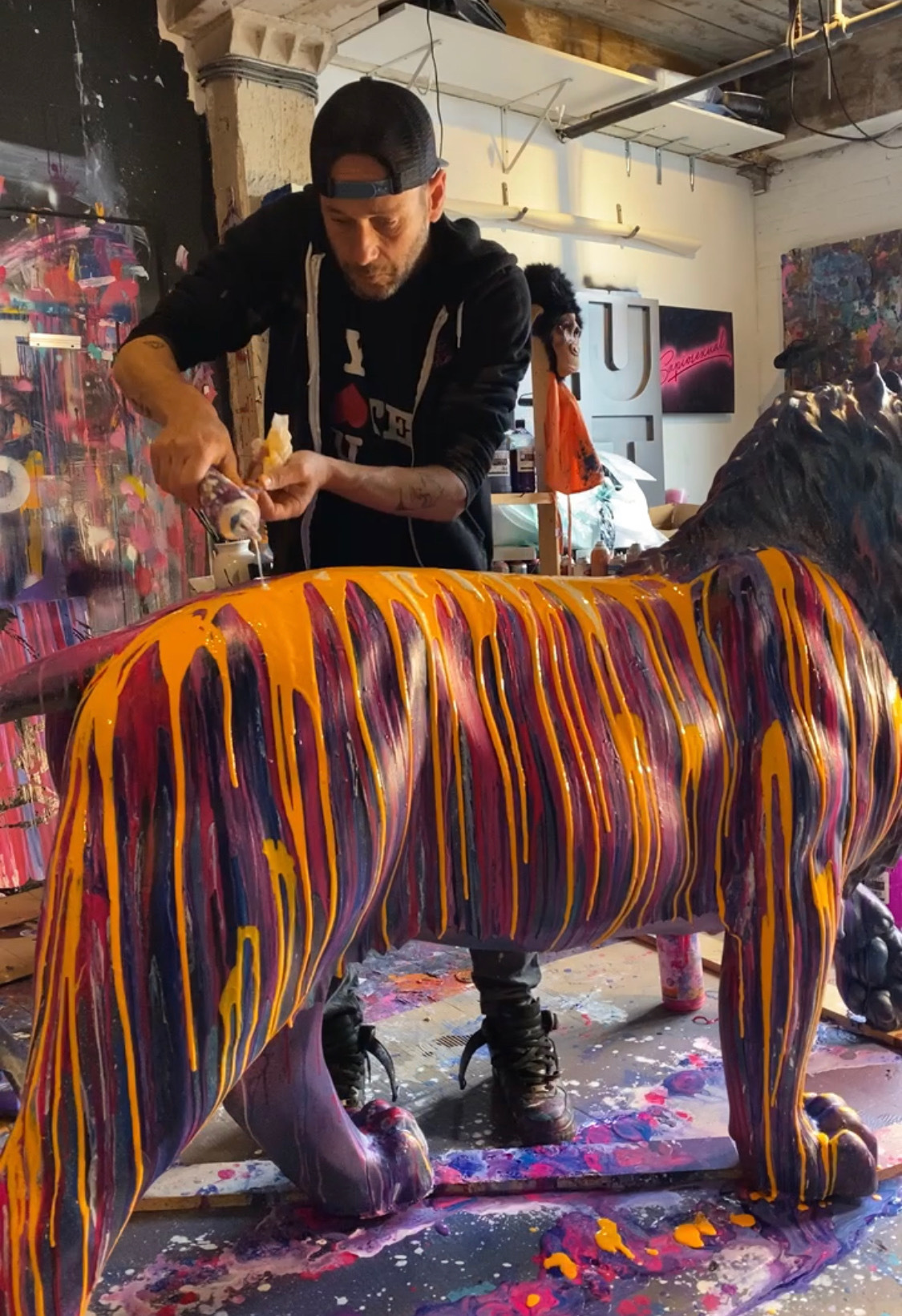 Jeremy Penn works on his lion sculpture,