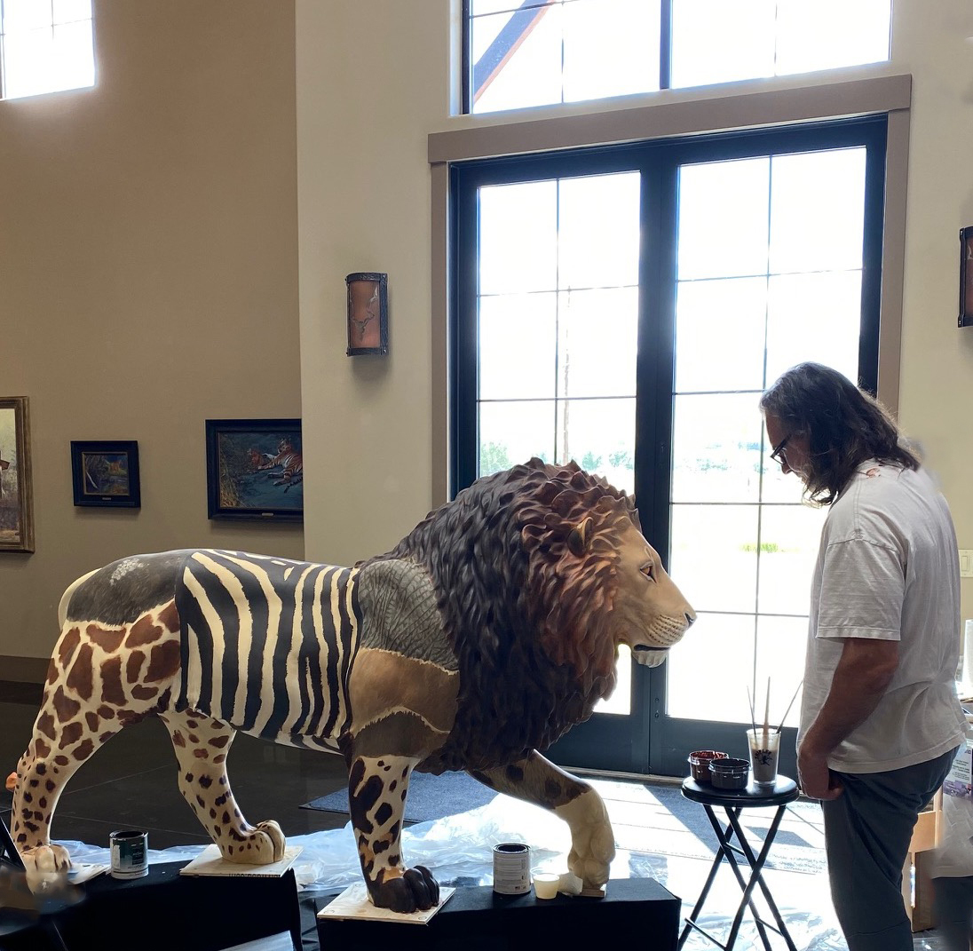 John Banovich with his lion sculpture,