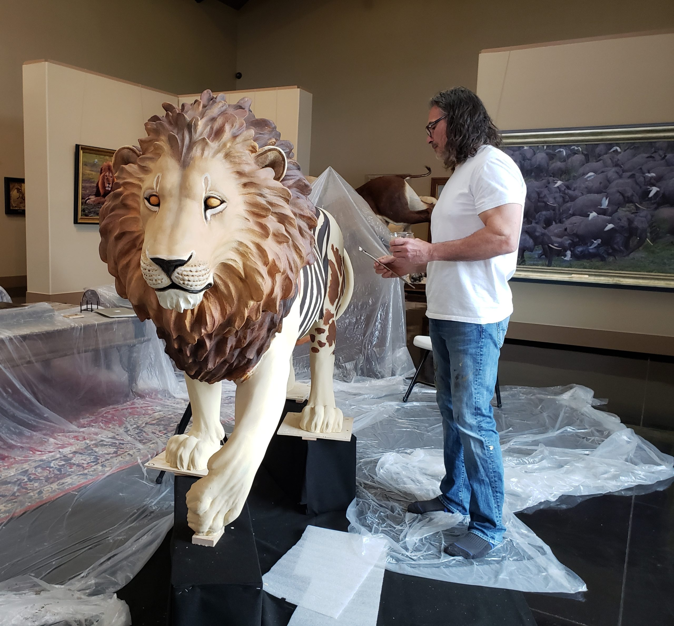 John Banovich works on his lion sculpture,