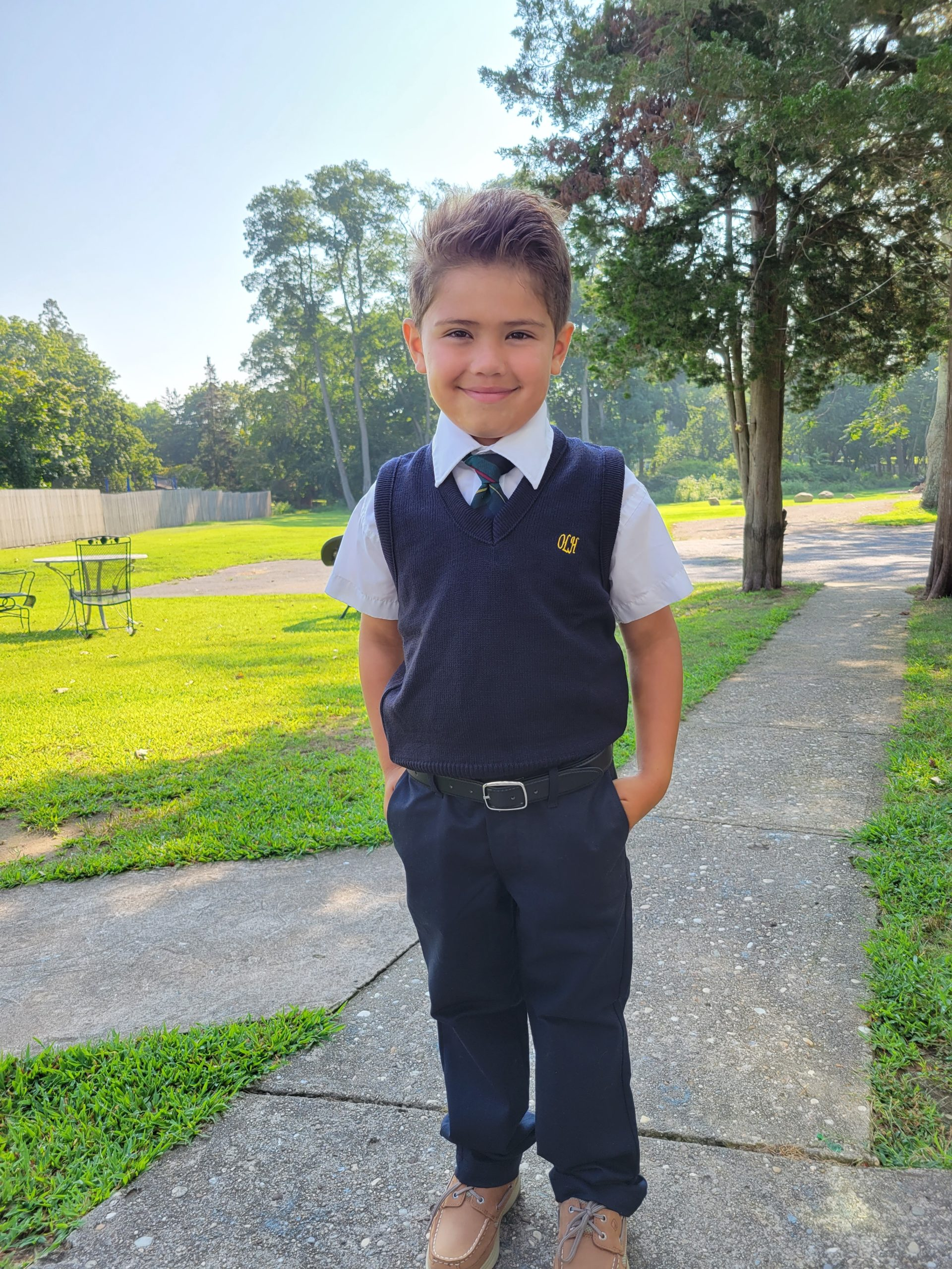 :  Incoming first grader Santiago Springer shows off his new uniform.