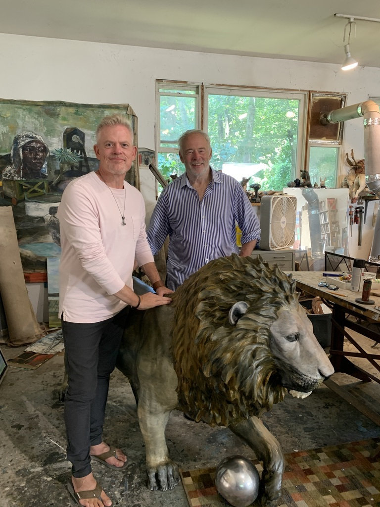 Brady Forseth, CEO of the African Community & Conservation Foundation, with artist Paton Miller and his artistic lion in his Southampton studio.