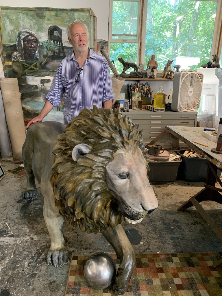 Artist Paton Miller and his artistic lion in his Southampton studio.