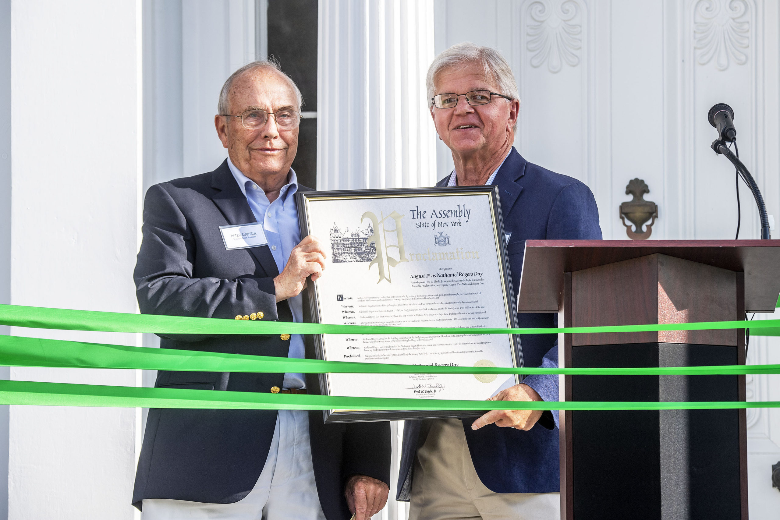 New York State Assemblyman Fred Thiele presents Bridgehampton Museum Board President Peter Sughrue with a proclamation naming August 1st as Nathaniel Rogers Day during a ribbon-cutting ceremony that was held to inaugurate the new, completely refurbished Nathaniel Rogers House at the corner of Ocean Road and Montauk Highway on Sunday. MICHAEL HELLER