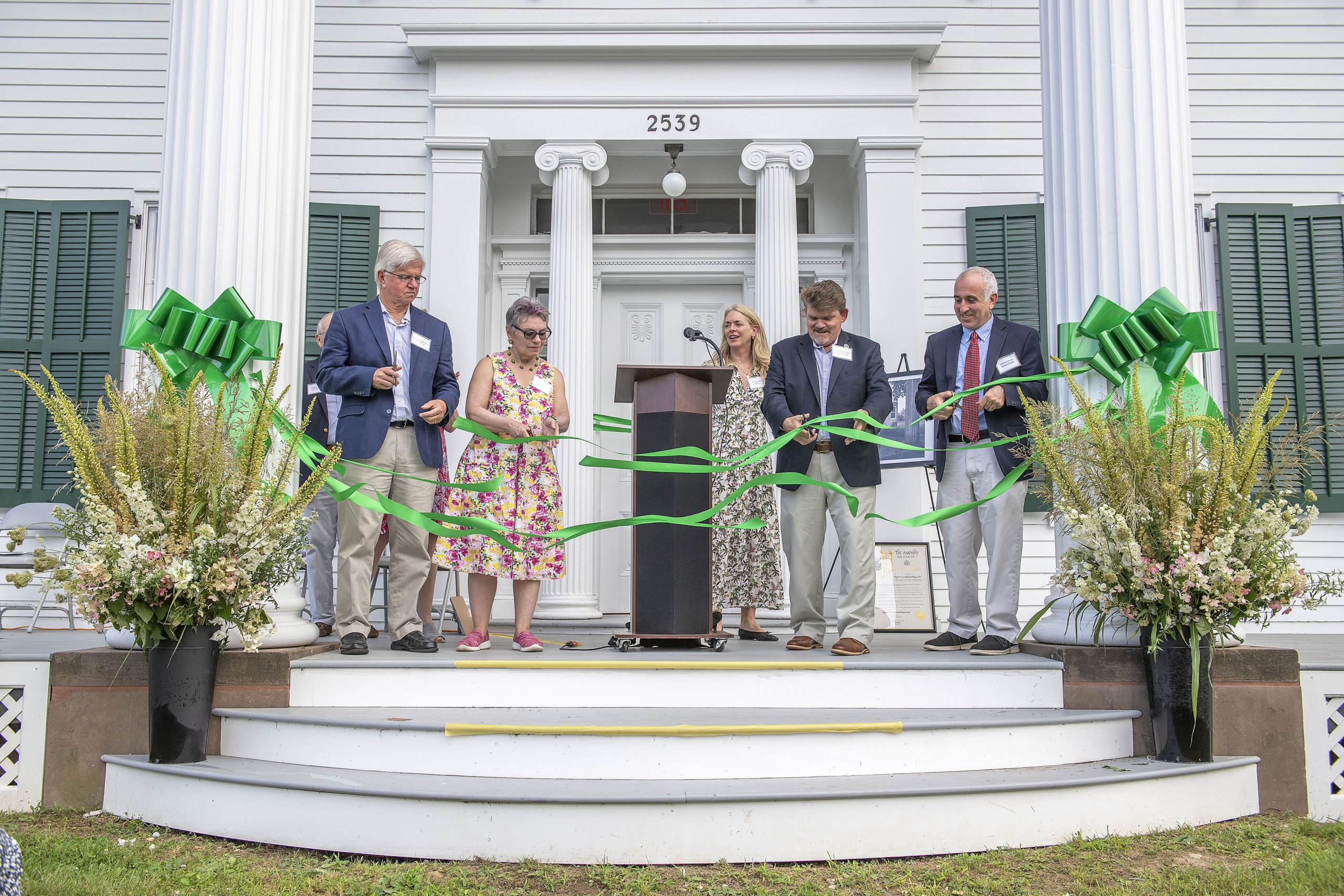 New York State Assemblyman Fred Thiele, Community Preservation Fund Manager Lisa Kombrink, Southampton Town Board Board Member Tommy John Schiavoni and Southampton Town Supervisor Jay Schneiderman cut the ribbon(s) during a ceremony that was held to inaugurate the new, completely refurbished Nathaniel Rogers House at the corner of Ocean Road and Montauk Highway on Sunday.   MICHAEL HELLER