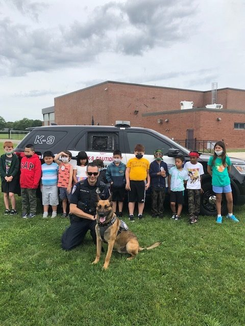 Students participating in the Southampton Union Free School District's Extended School Year Program recently enjoyed a two-part visit with local police officers. Among the topics discussed were the differences between emergencies and non-emergencies, how to provide information to 911 dispatchers, the job of a police officer, the inner workings of police vehicles and sirens, and K-9 training and handling.