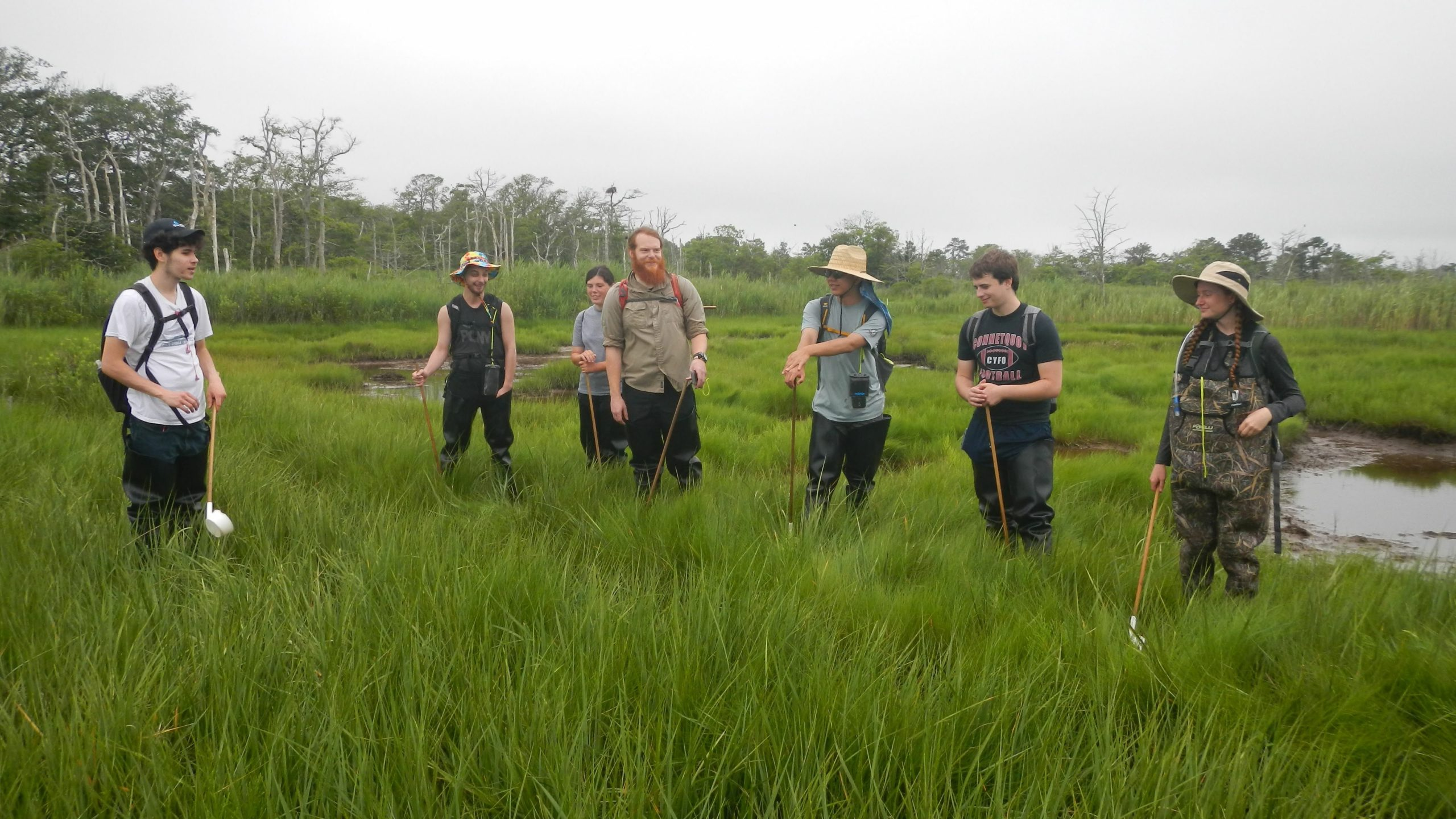Suffolk County Community College interns prepare to take environmental samples in a south shore salt marsh. From left: Jake Montgomery, David Ziff, Jessica Cormier, Field Supervisor Nicholas Cormier, Brendan Lin, Kyler Vander Putten, and Grace Nelson.