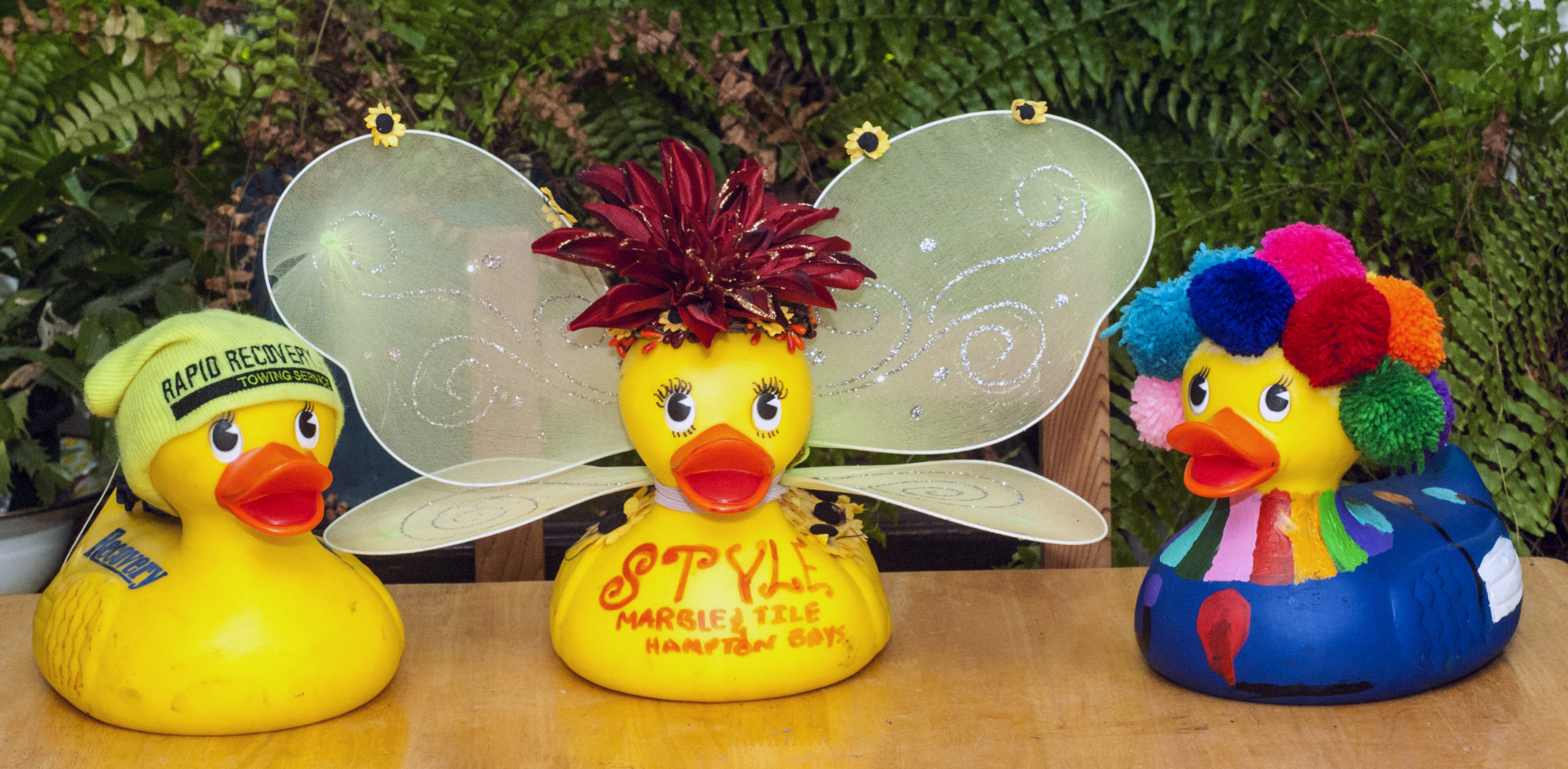 The winners of the 2021 Hampton Bays Civic Association Rubber Ducky race were: First place, Ce Style Marble, center; Second place, Rapid Recovery, left: and third Place, Peconic Physical Therapy at right.  COURTESY HAMPTON BAYS CIVIC ASSOCIATION