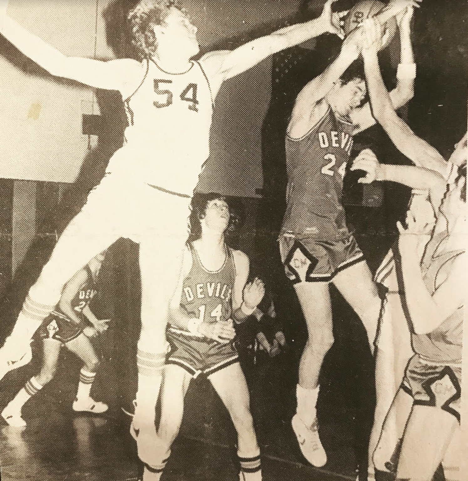 Art Jones playing basketball, he attended Hamilton College on a basketball scholarship.