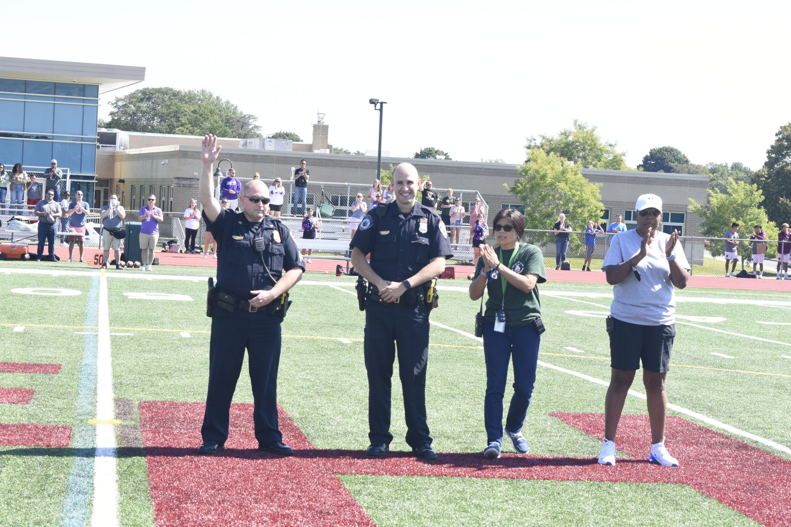 East Hampton Village Police Officer Matthew Morgan, left, East Hampton Town Police Officer Joseph Izzo and East Hampton Village Ambulance members Marcia Dias and Samone Johnson were honored prior to the East Hampton football game this past Saturday, September 11.