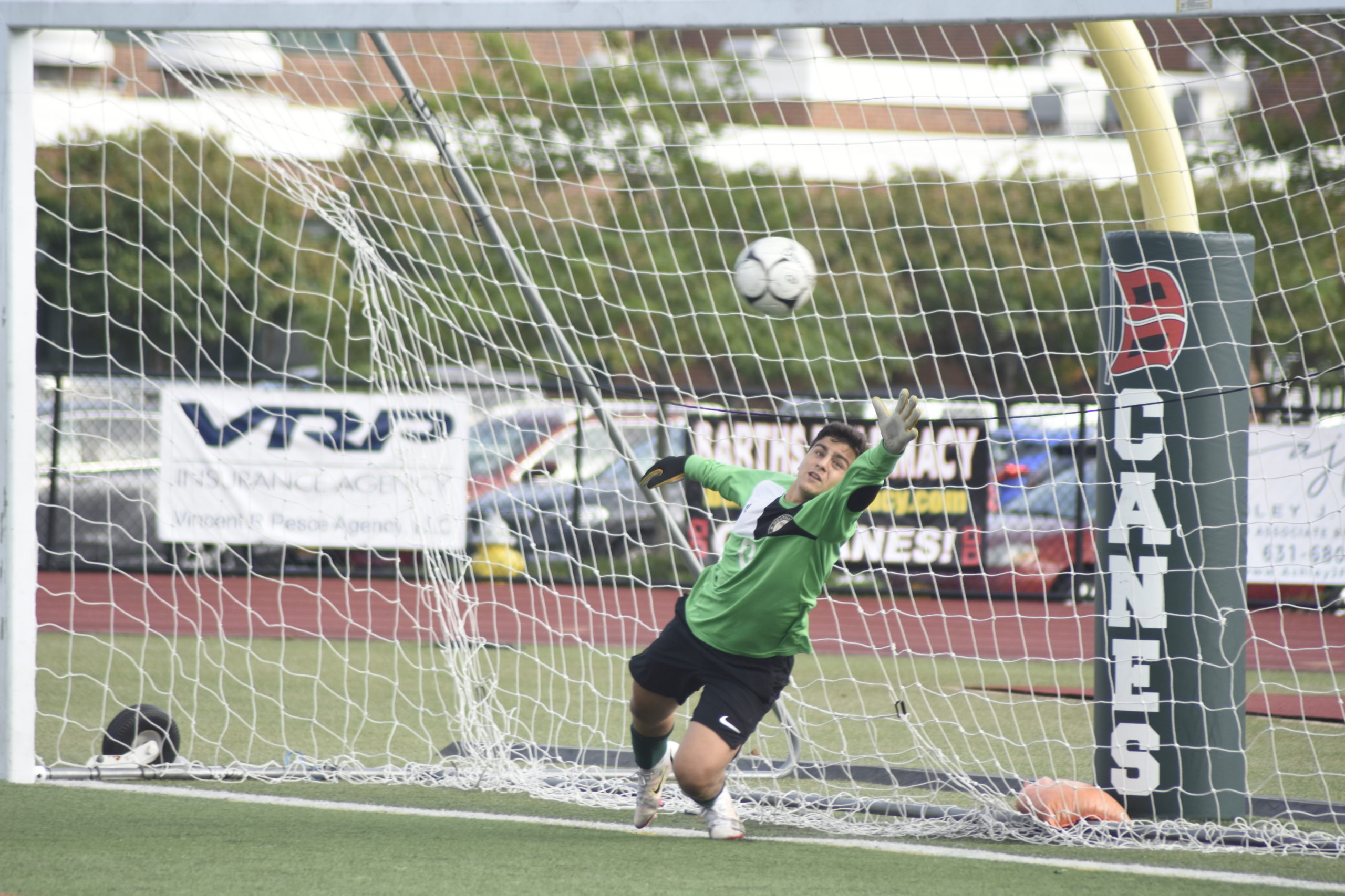 Westhampton Beach senior goalie Alessandro Volpe goes all out to try and make a save on a penalty kick but to no avail.