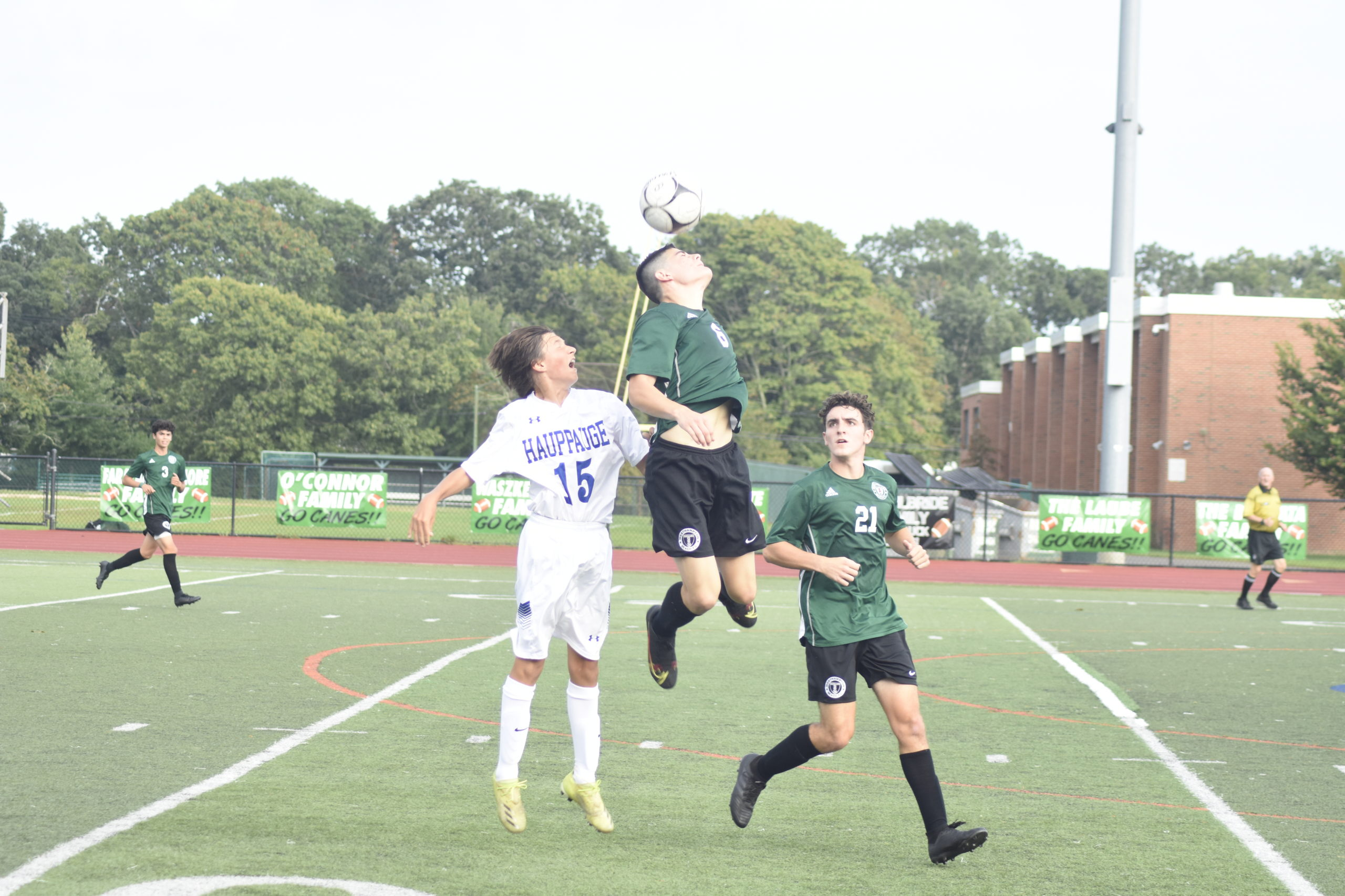 Westhampton Beach sophomore Montgomery Hahn beats a Hauppauge player to the ball in the air.