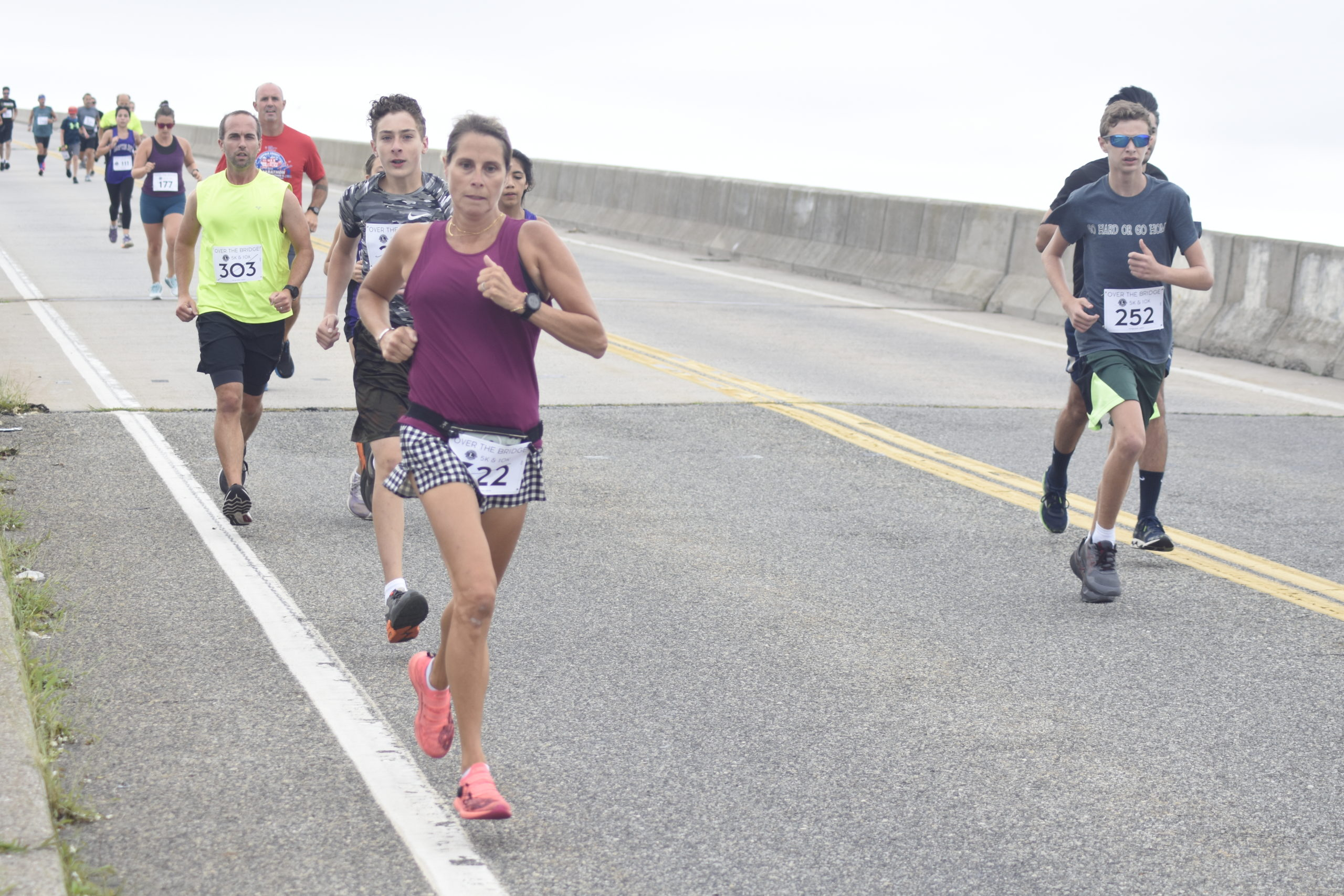 Runners make their descent over Ponquogue Bridge on Saturday morning for the Over The Bridge 10K and 5K races.
