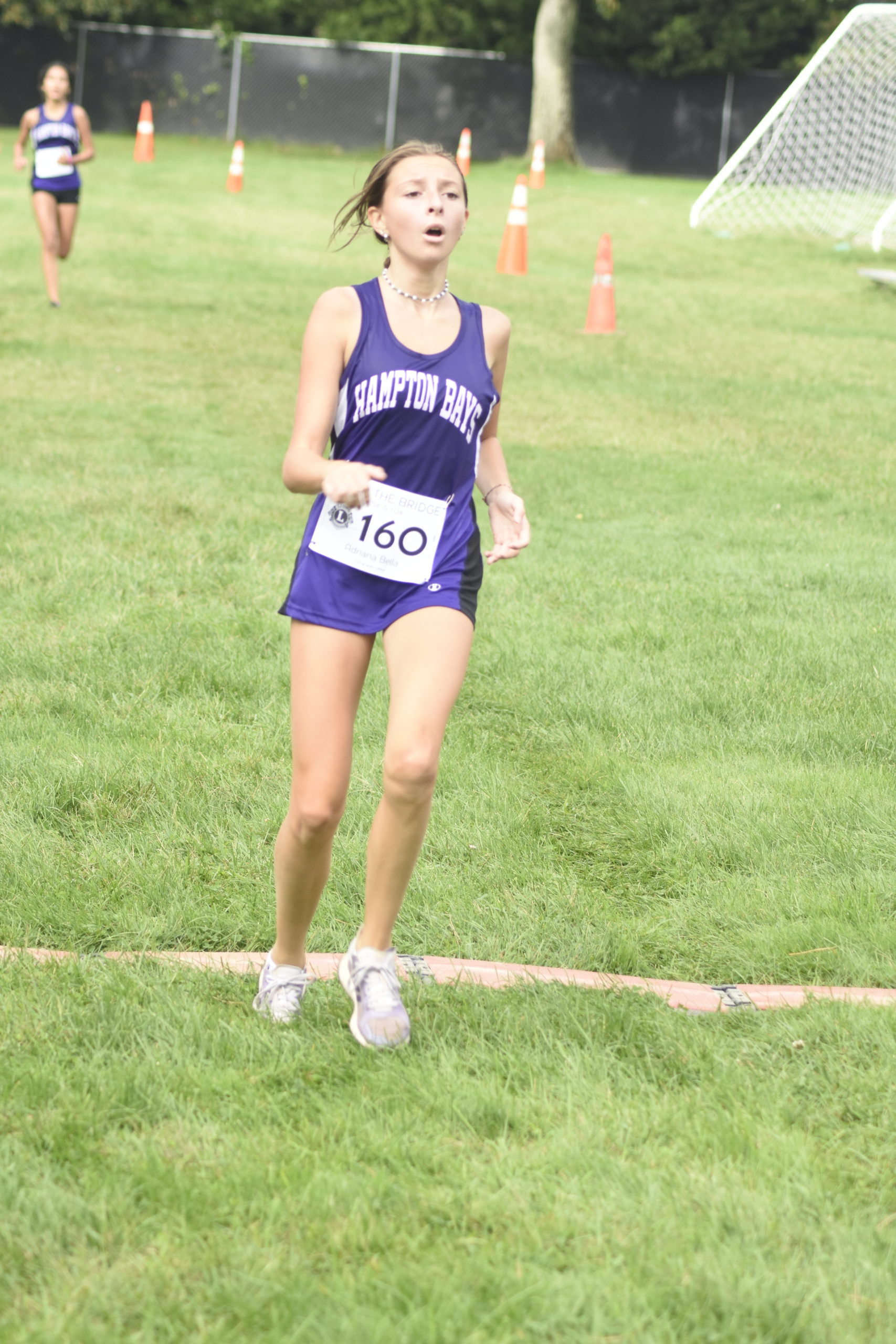 Adriana Bella Tapfer, 13, of Hampton Bays, and a member of the Baymen cross country team, finished second among women.