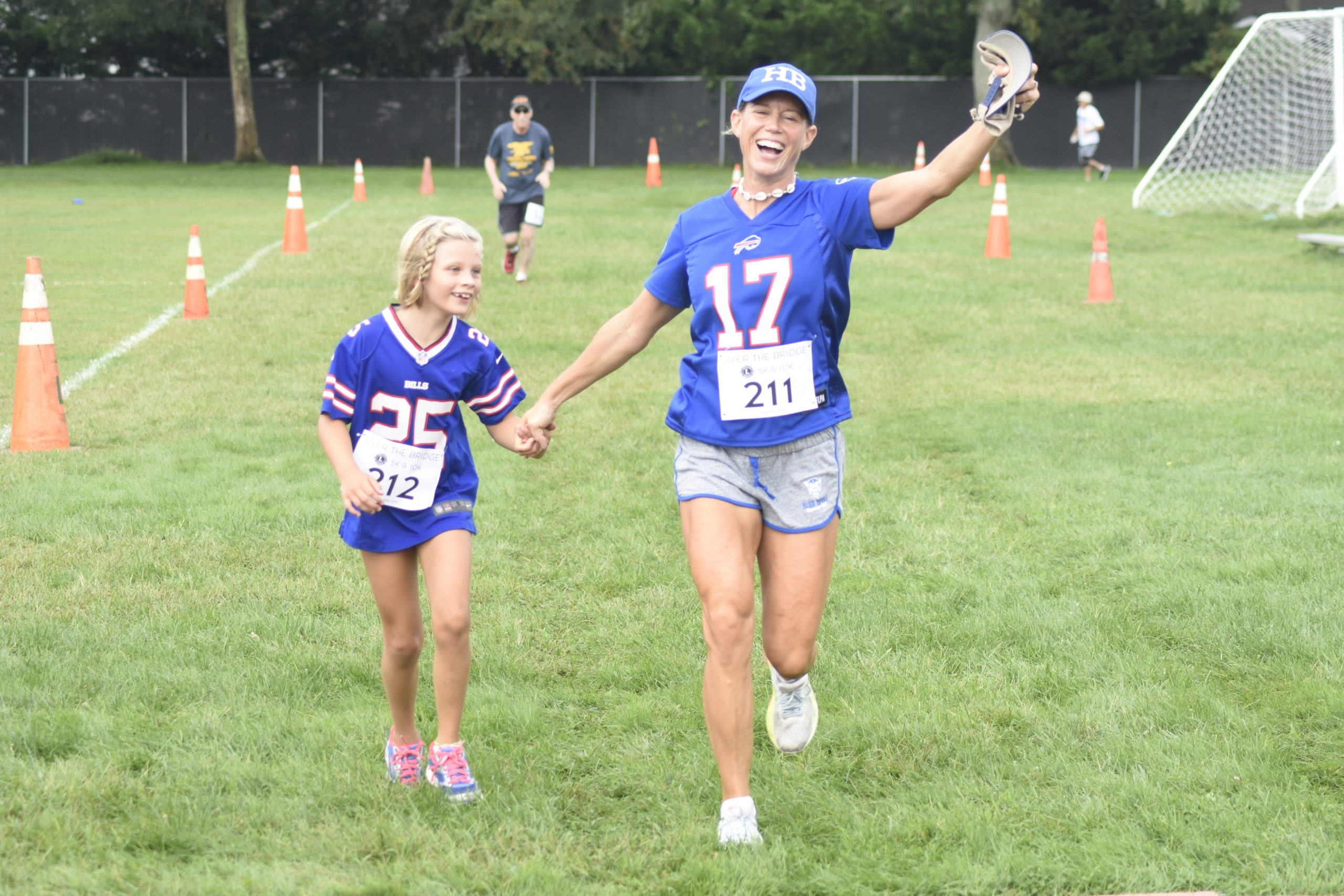 Anabel, left, and Jessica Ramsay of Hampton Bays cross the finish line together.