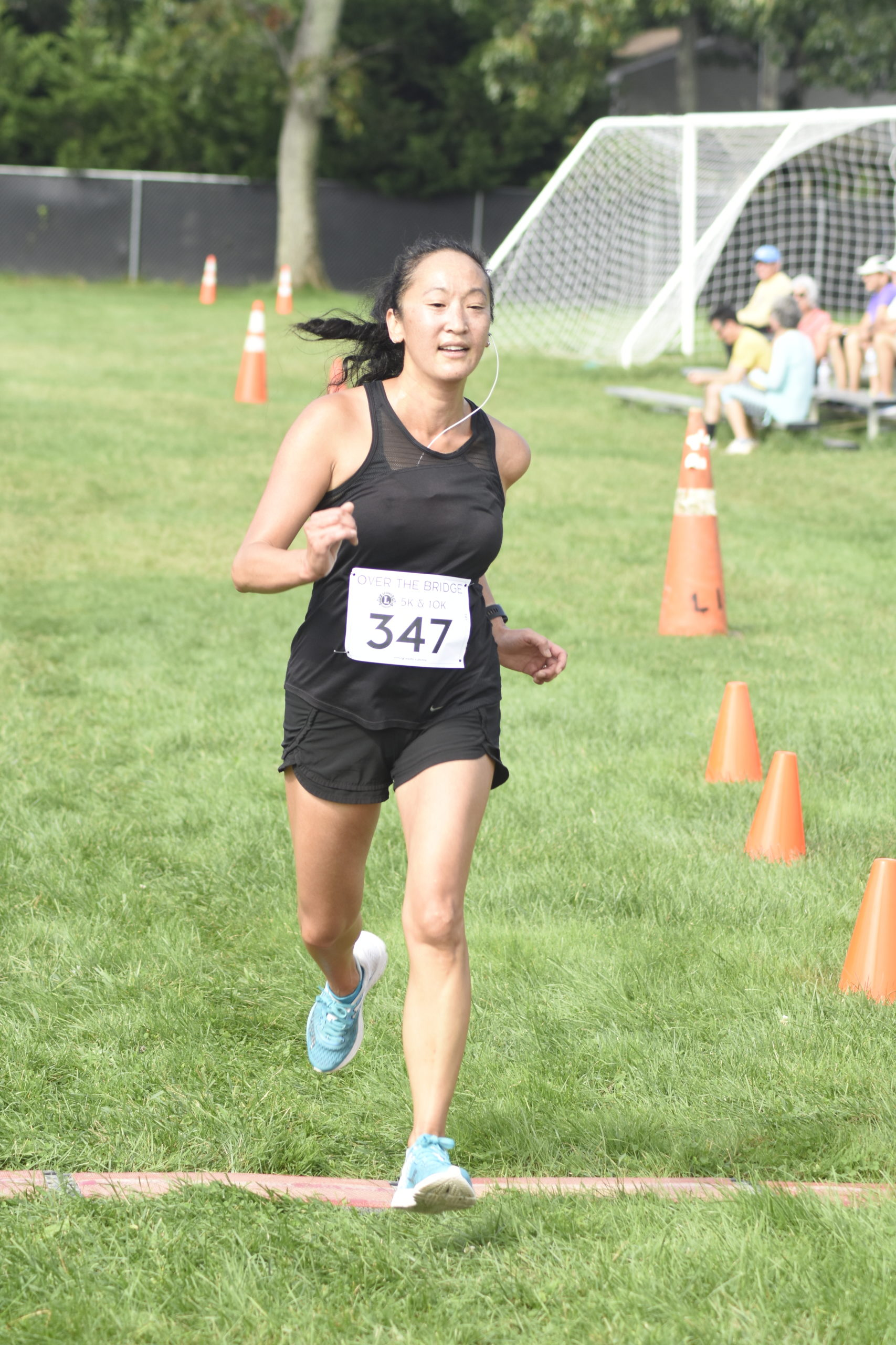 Angela Kim of Manorville placed third among women in the 10K.