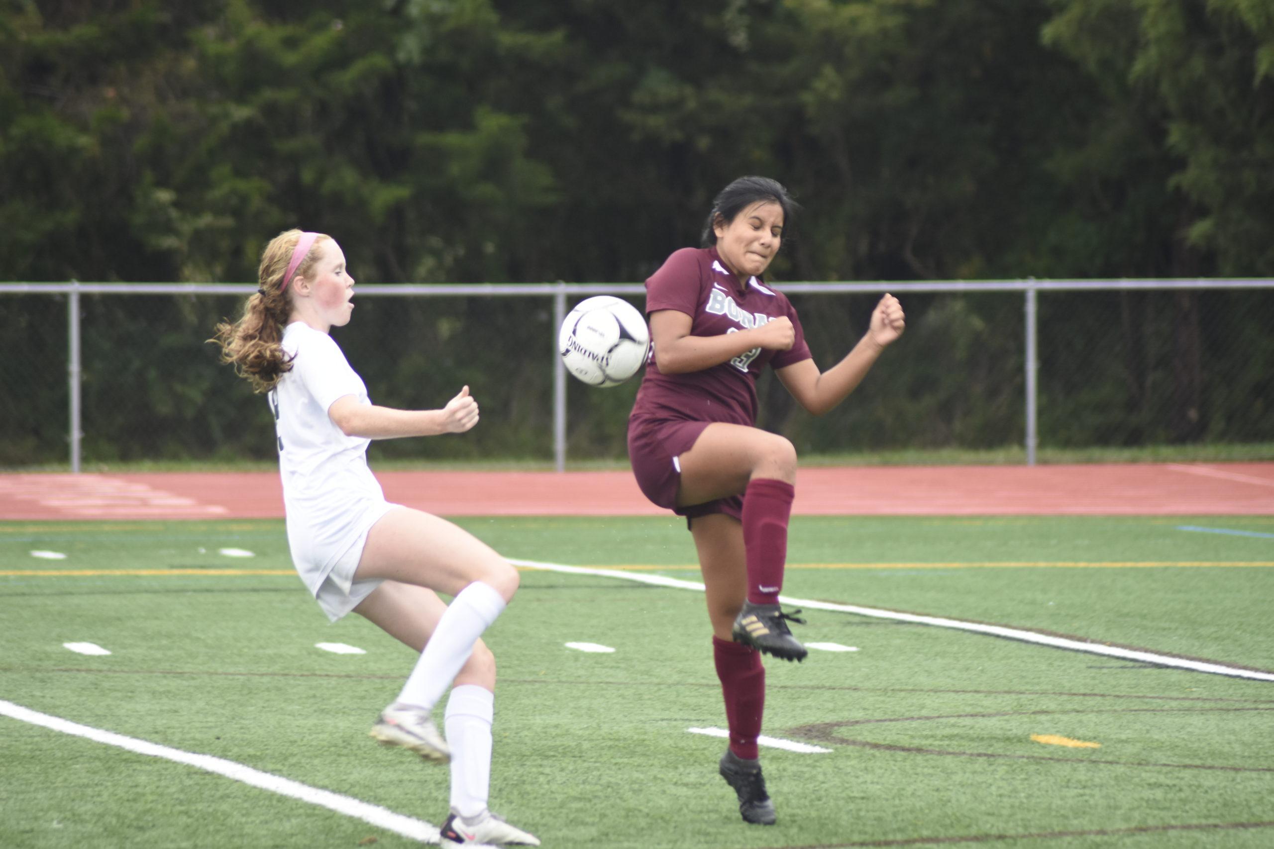East Hampton junior Jocelyn Prieto blocks a ball sent by Westhampton Beach sophomore Sarah Gormley.