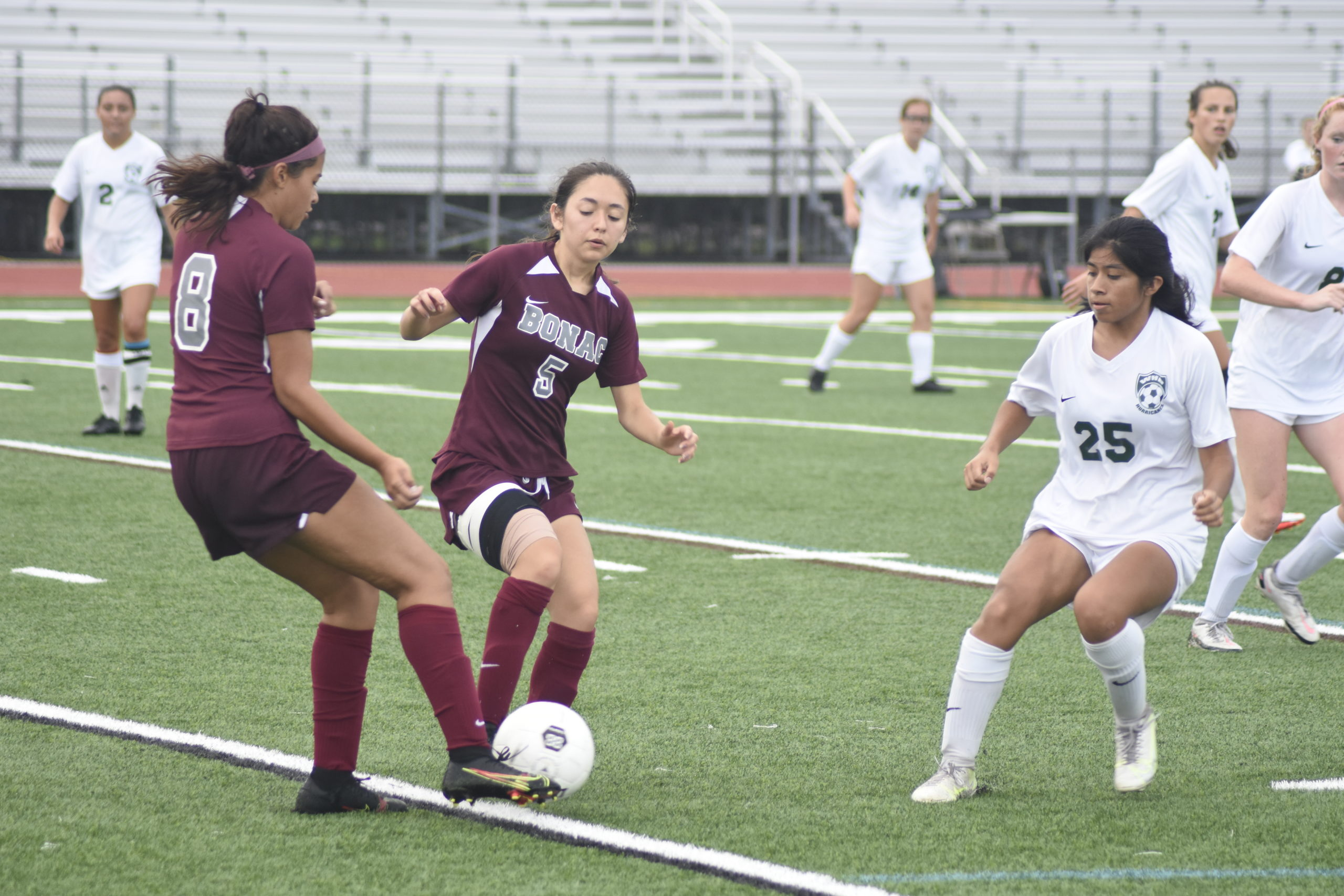 Bonackers Daniela Chavez (5) and Melanie Luque try to avoid one another as Hurricane Sintia Gregorio pressures them.