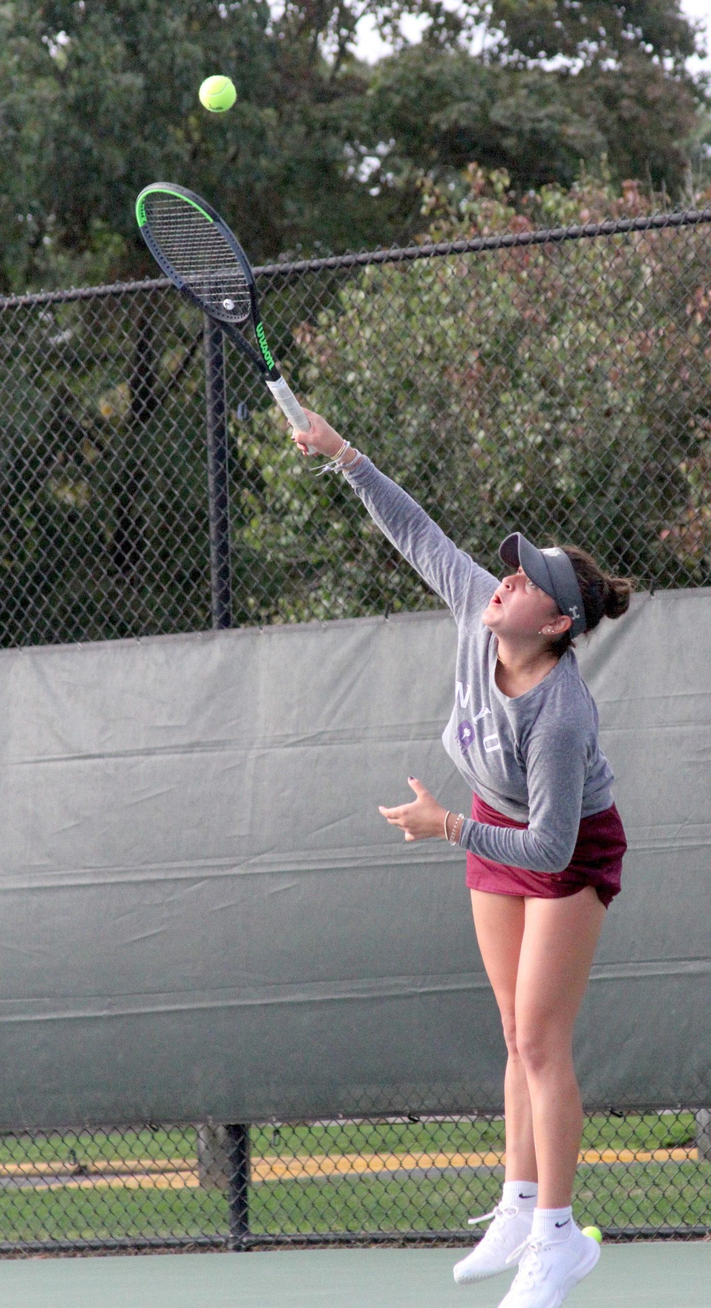 Pierson senior Sandrine Becht serves the the ball at the No. 1 singles spot for East Hampton. DESIRÉE KEEGAN