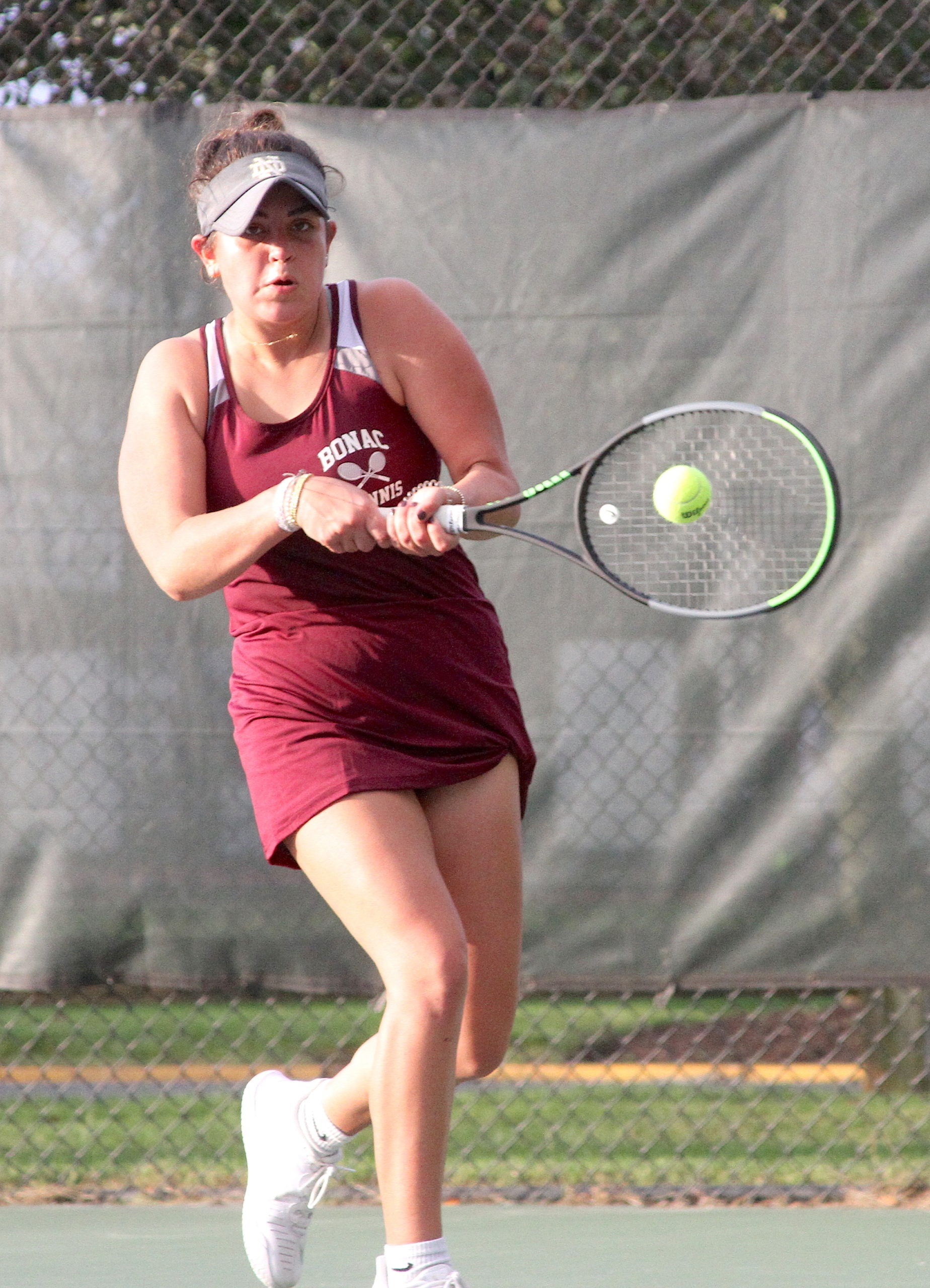Pierson senior Sandrine Becht keeps a volley going for East Hampton at No. 1 singles. DESIRÉE KEEGAN