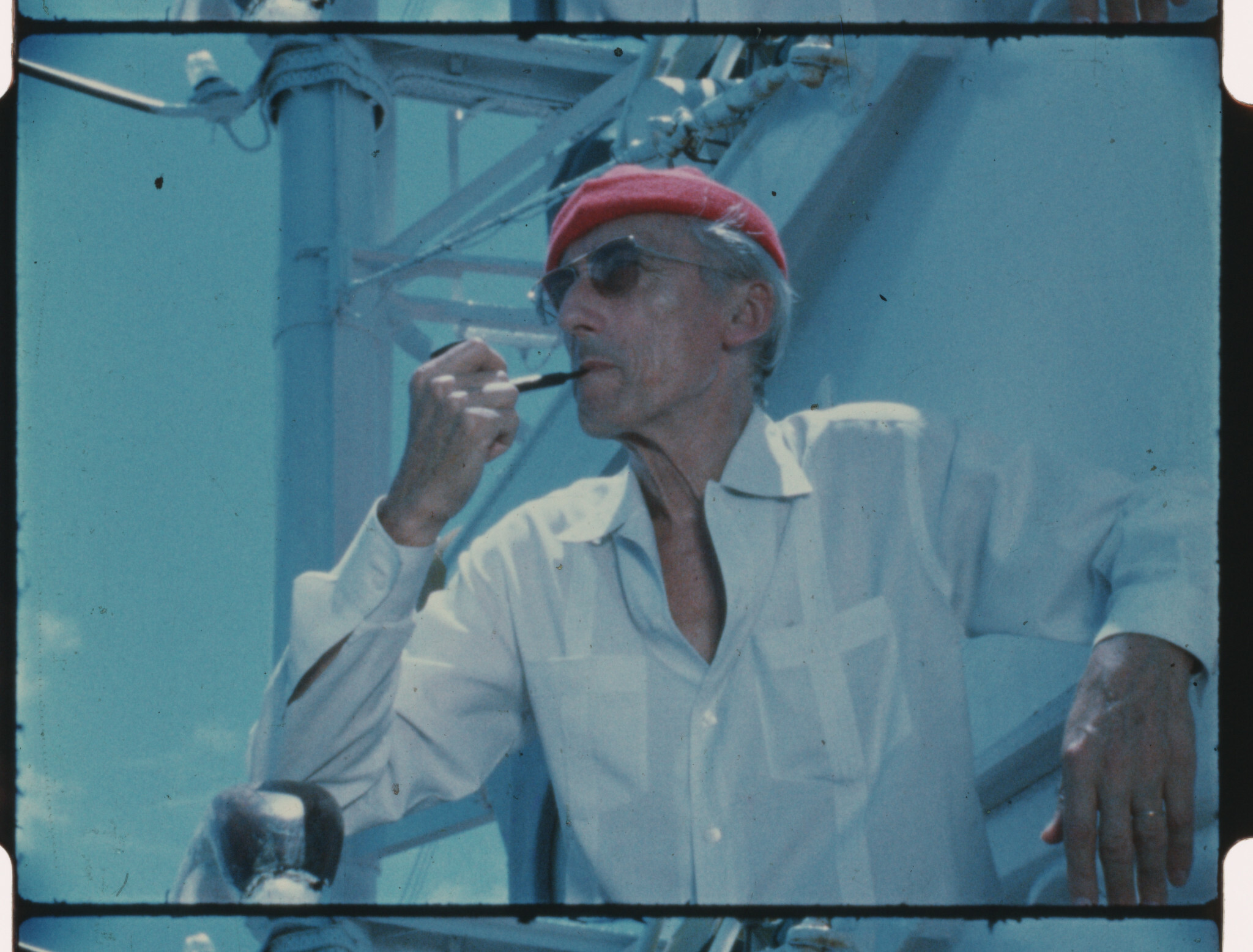 Jacques Cousteau wears his iconic red diving cap aboard his ship Calypso, circa 1970s. Photo: The Cousteau Society.