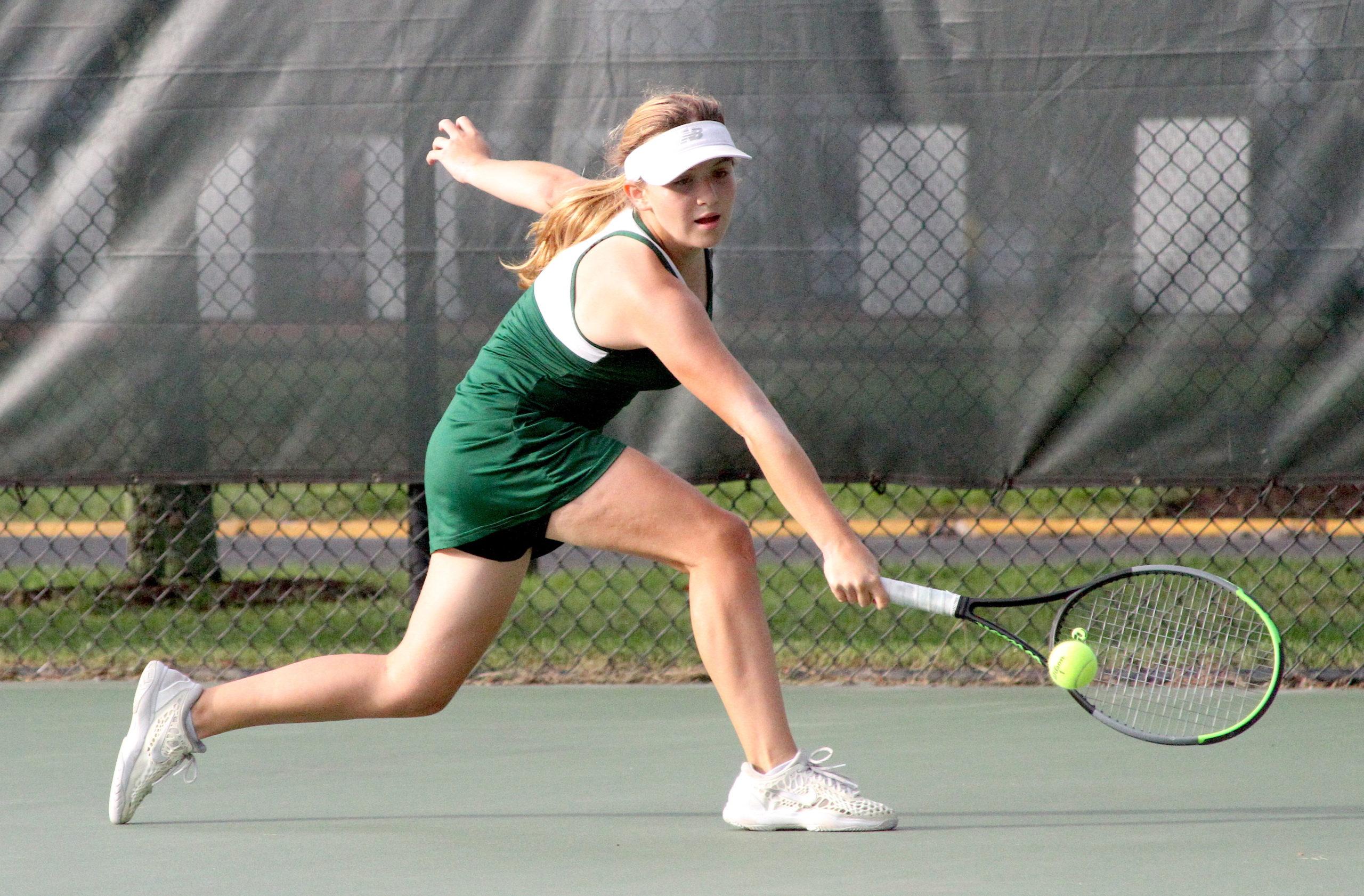 Westhampton Beach freshman Matilda Buchen reaches for a return at No. 1 singles. DESIRÉE KEEGAN