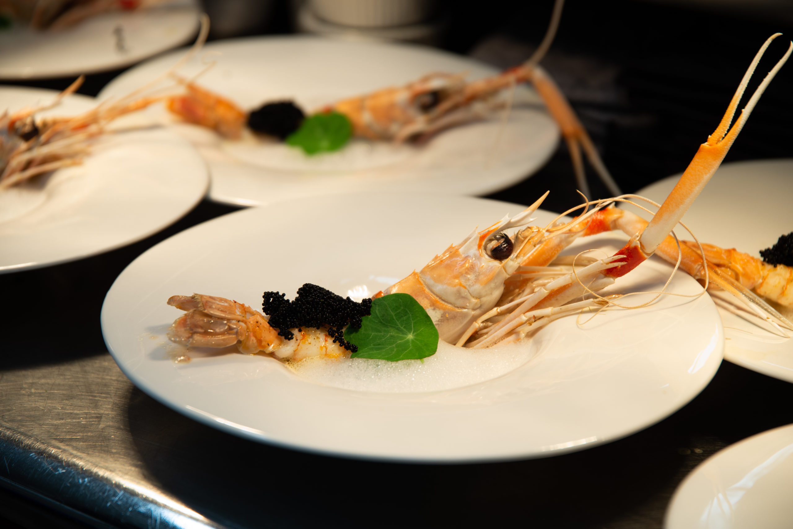 Cigalas, a dish featuring Norwegian prawns, fermented black beans and lemon air, as part of the R.AIRE dining experience at The Hampton Maid in Hampton Bays.