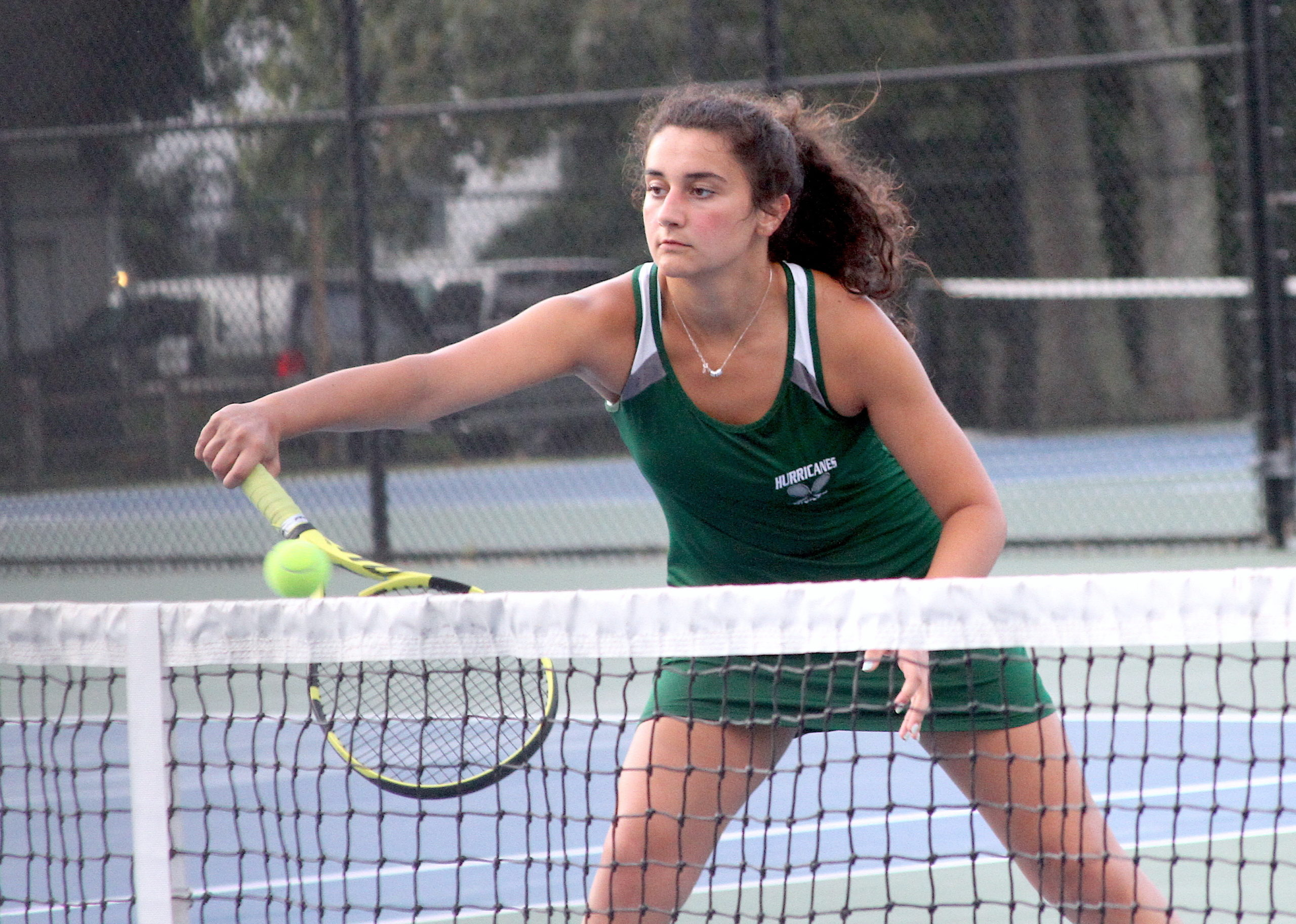 Westhampton Beach senior Emily D'Alessandro catches a ball at the net for her No. 1 doubles team. DESIRÉE KEEGAN