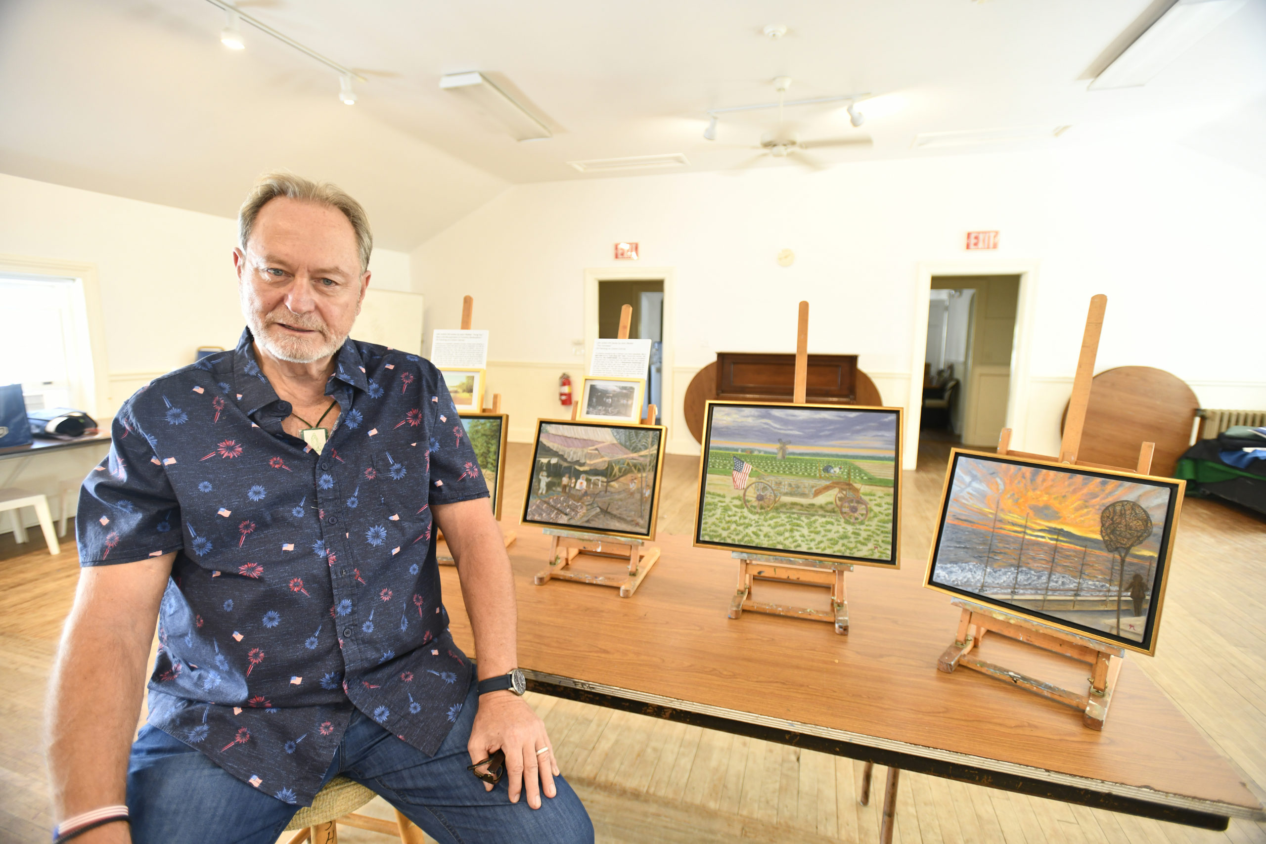John Melillo with some of his work at the Southampton Cultural Center.  DANA SHAW