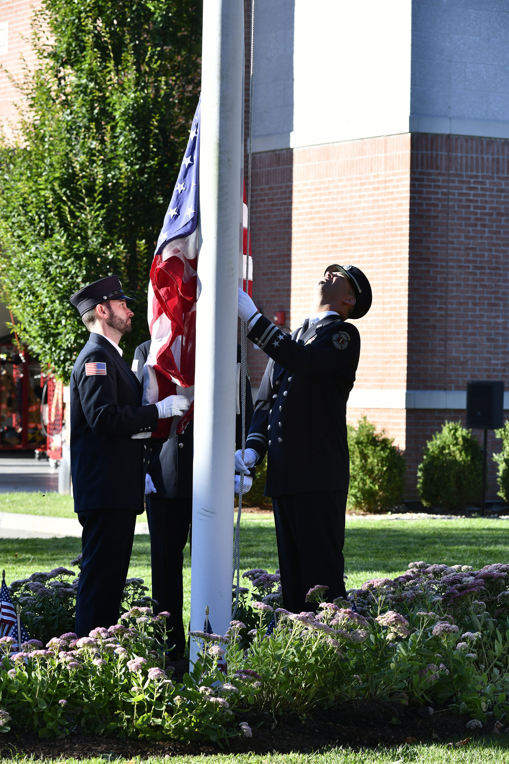 The Color Guard presents and raises the flag at the Southampton Fire Department ceremony on Saturday.