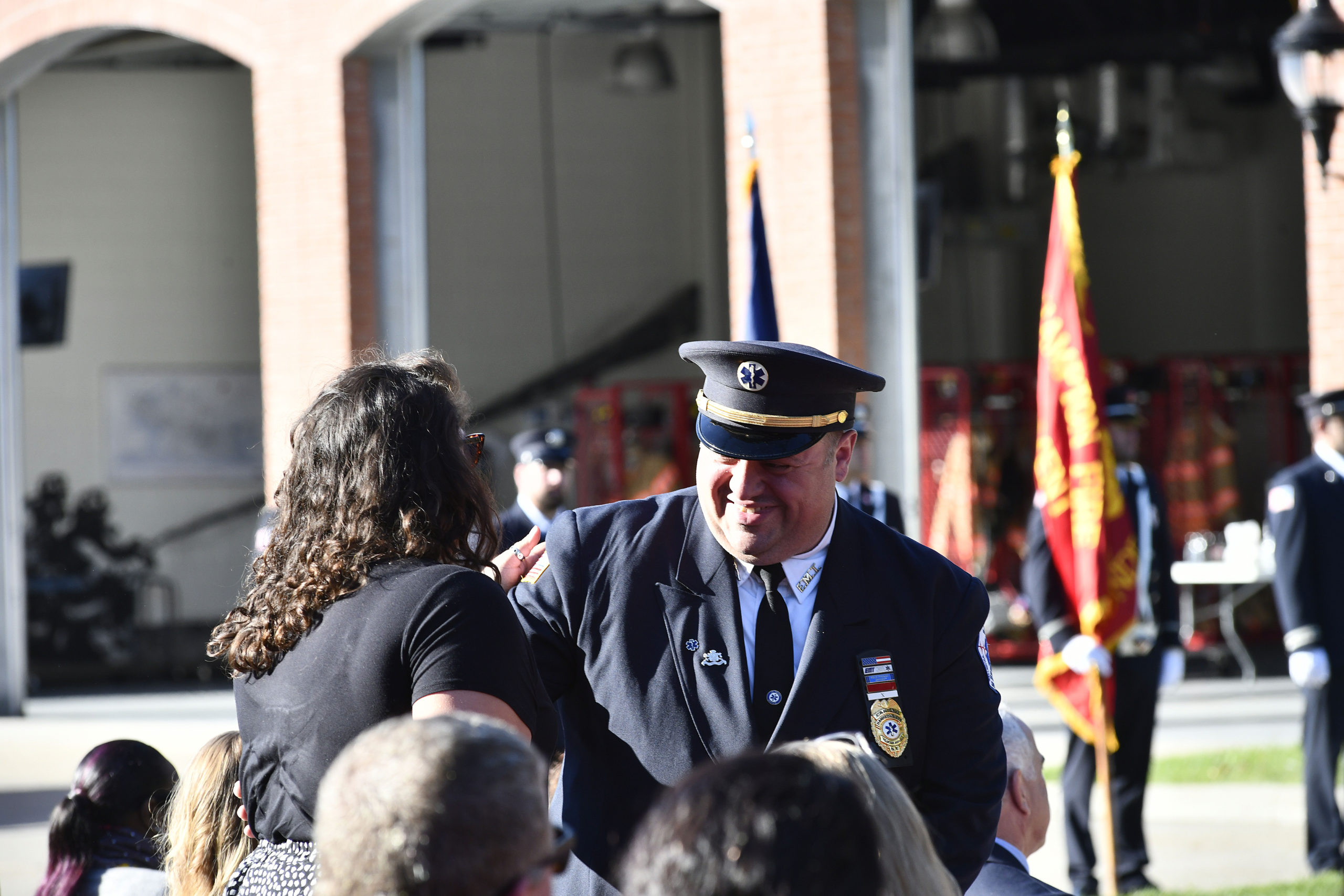 Speaker Matthew O'Connor of Hampton Bays with his daughter. O'Connor spoke about his experience on 9/11. He is a member of the Hampton Bays Volunteer Ambulance.